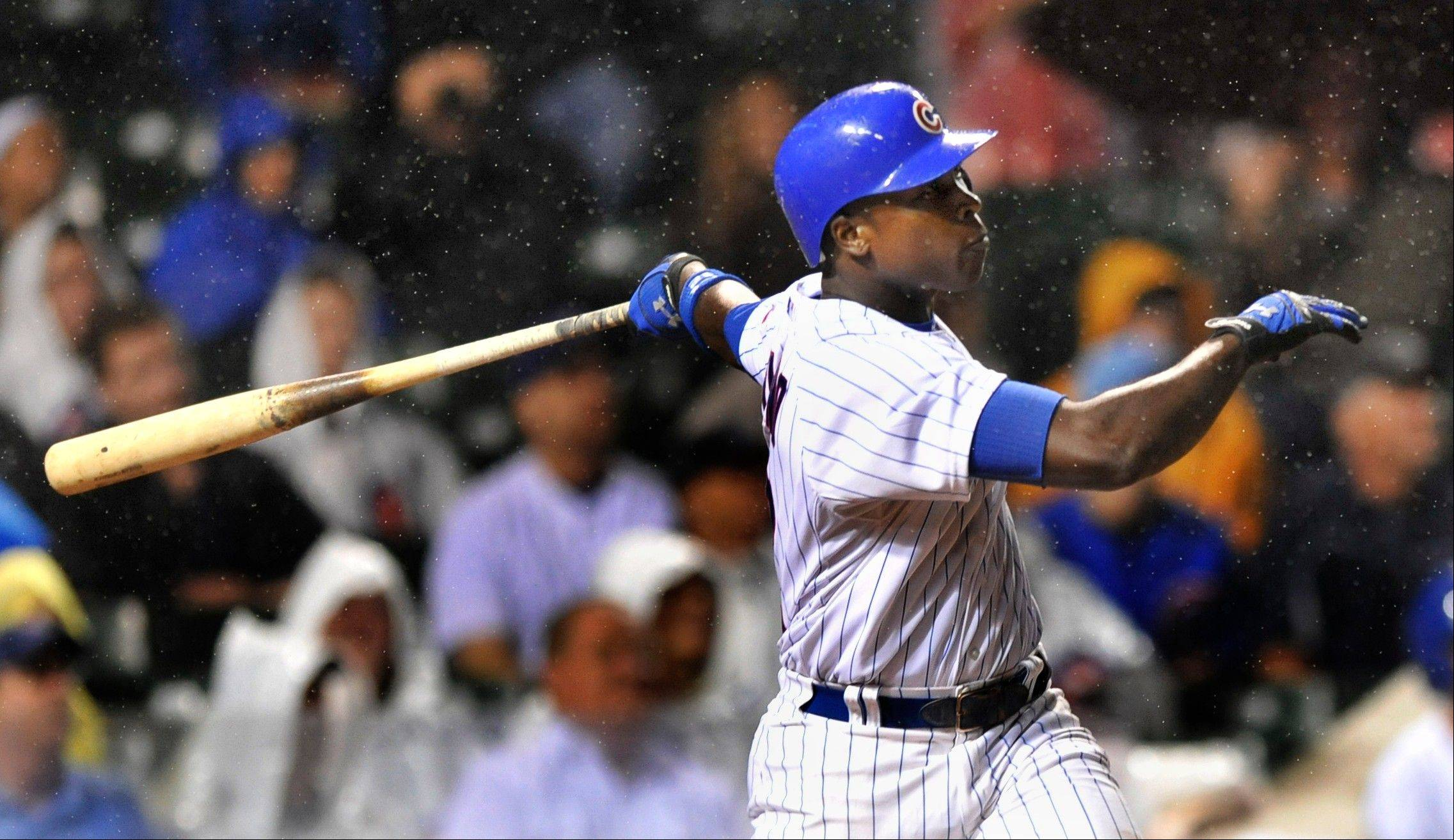 Chicago Cubs' Alfonso Soriano watches his two run home run against the Cincinnati Reds in the eighth inning during a MLB baseball game in Chicago, Thursday, Aug. 9, 2012. (AP Photo/Paul Beaty)