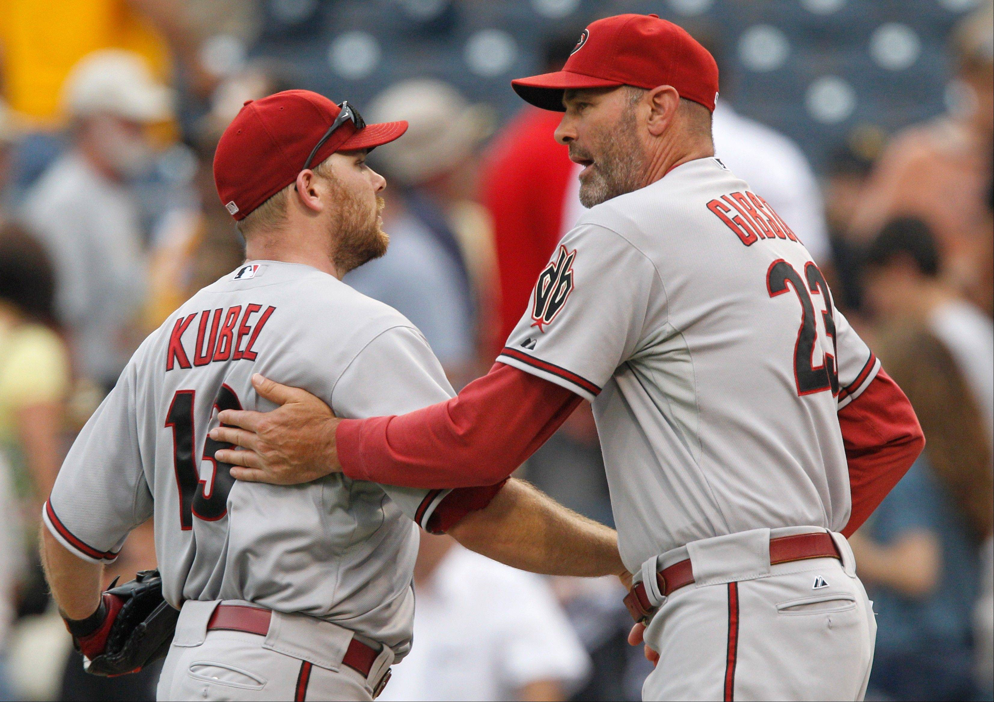 Diamondbacks manager Kirk Gibson, right, greets Jason Kubel after a win against the Pirates Thursday in Pittsburgh.
