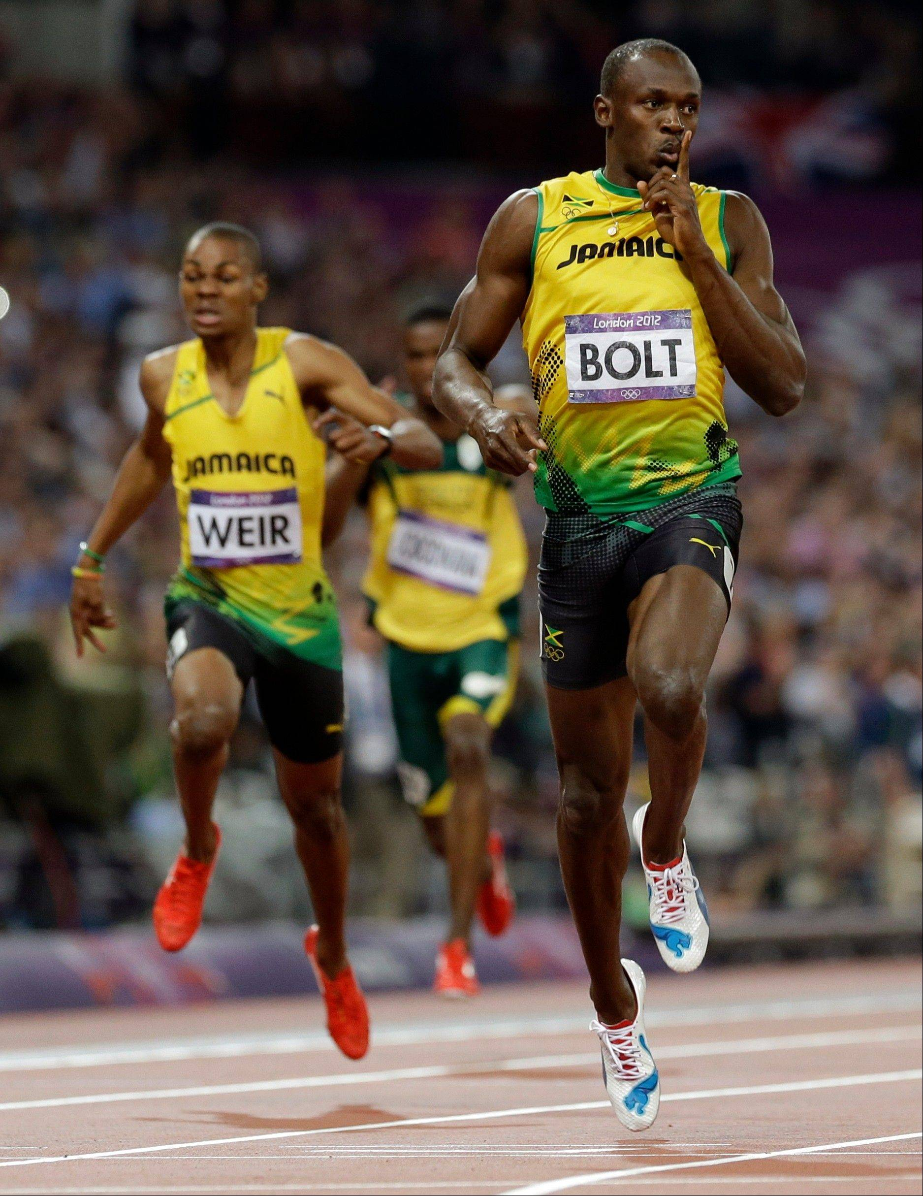 Jamaica's Usain Bolt celebrates Thursday as he crosses the finish line to win the men's 200-meter final.