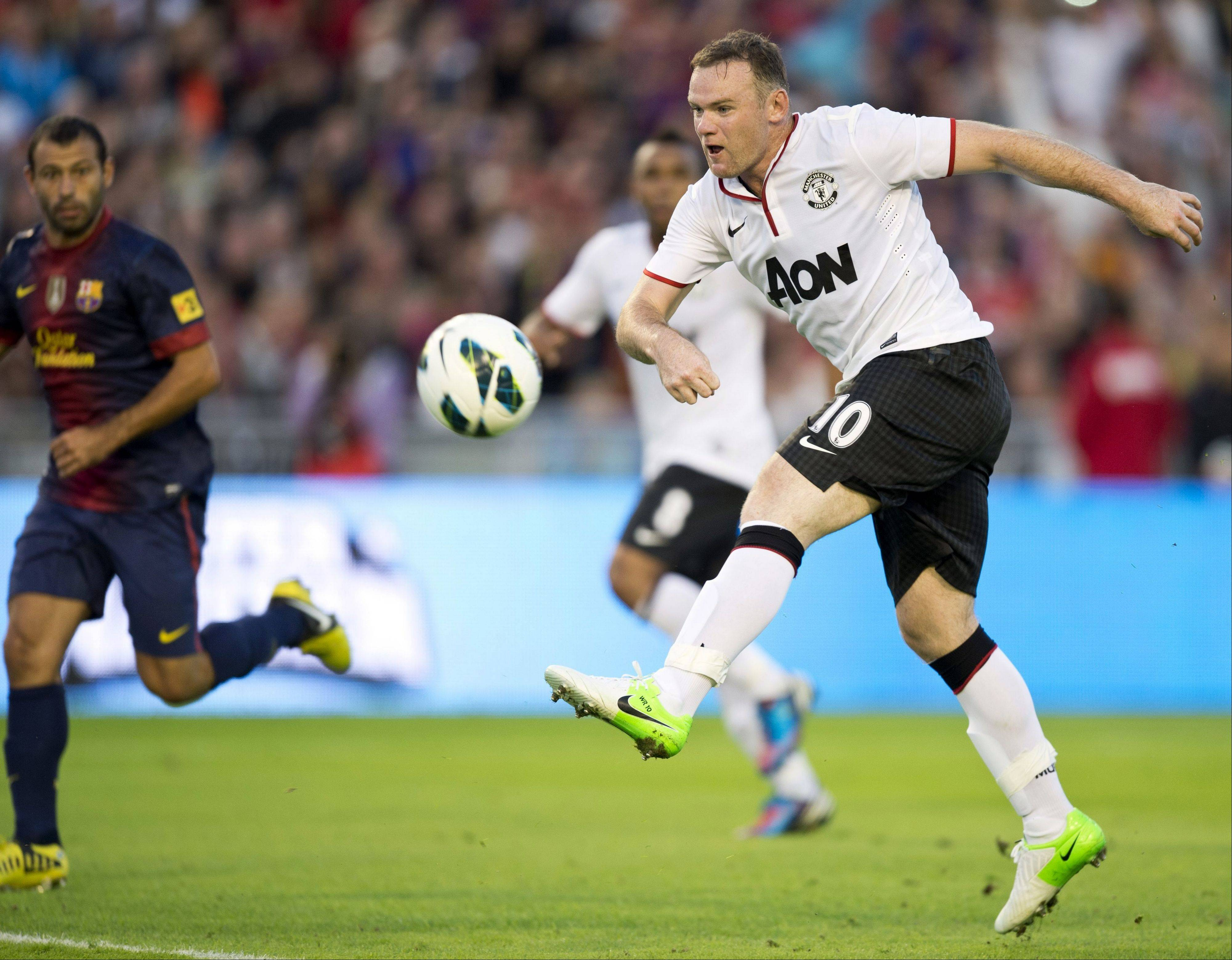Manchester United's Wayne Rooney, right, kicks the ball as Barcelona's Javier Mascherano, left, defends, during a friendly soccer match in Goteborg, Sweden, Aug. 8. Manchester United is readying for its debut on the New York Stock Exchange on Friday.