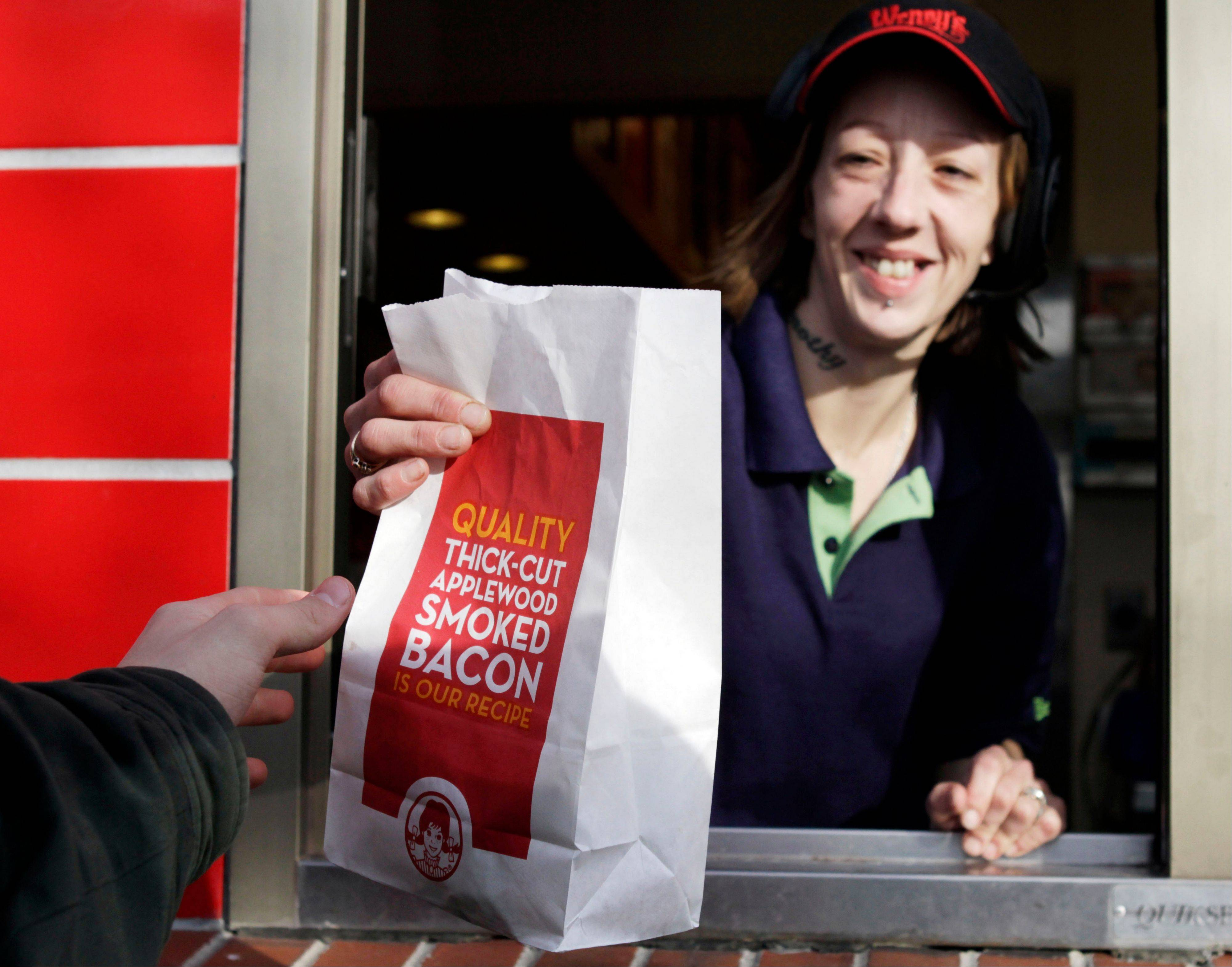 The Wendy's Co. says Thursday, Aug. 9, 2012 that it lost money in the second quarter because of costs to refinance debt. But a key sales figure rose as it worked to reinvent itself as a higher-end hamburger chain. The Dublin, Ohio-based fast-food company says sales at restaurants open at least 15 months rose 3.2 percent for the quarter.