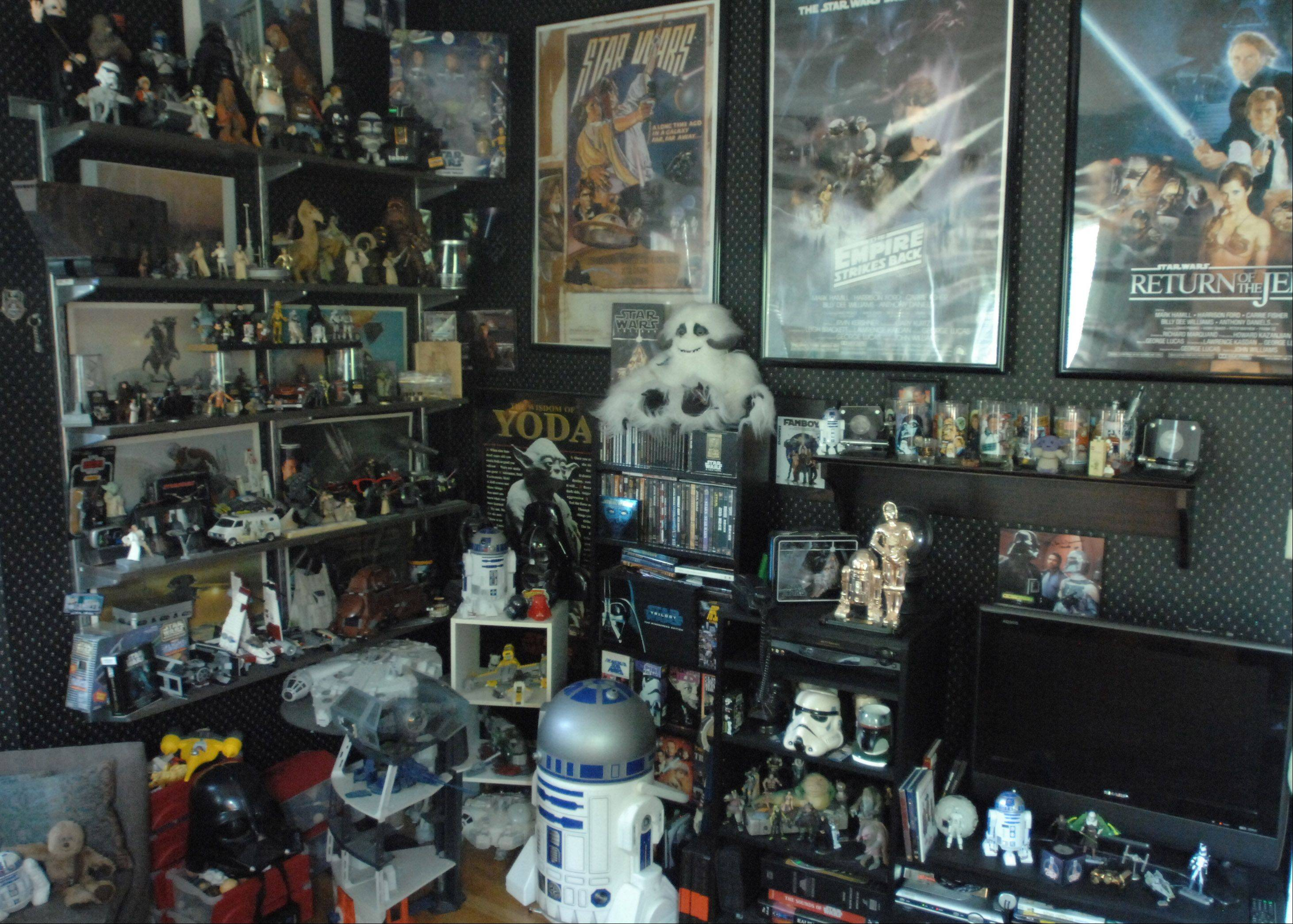 "Jimmy ""Mac"" McInerney has a large collection of figures, posters and other ""Star Wars"" items on display in his home."