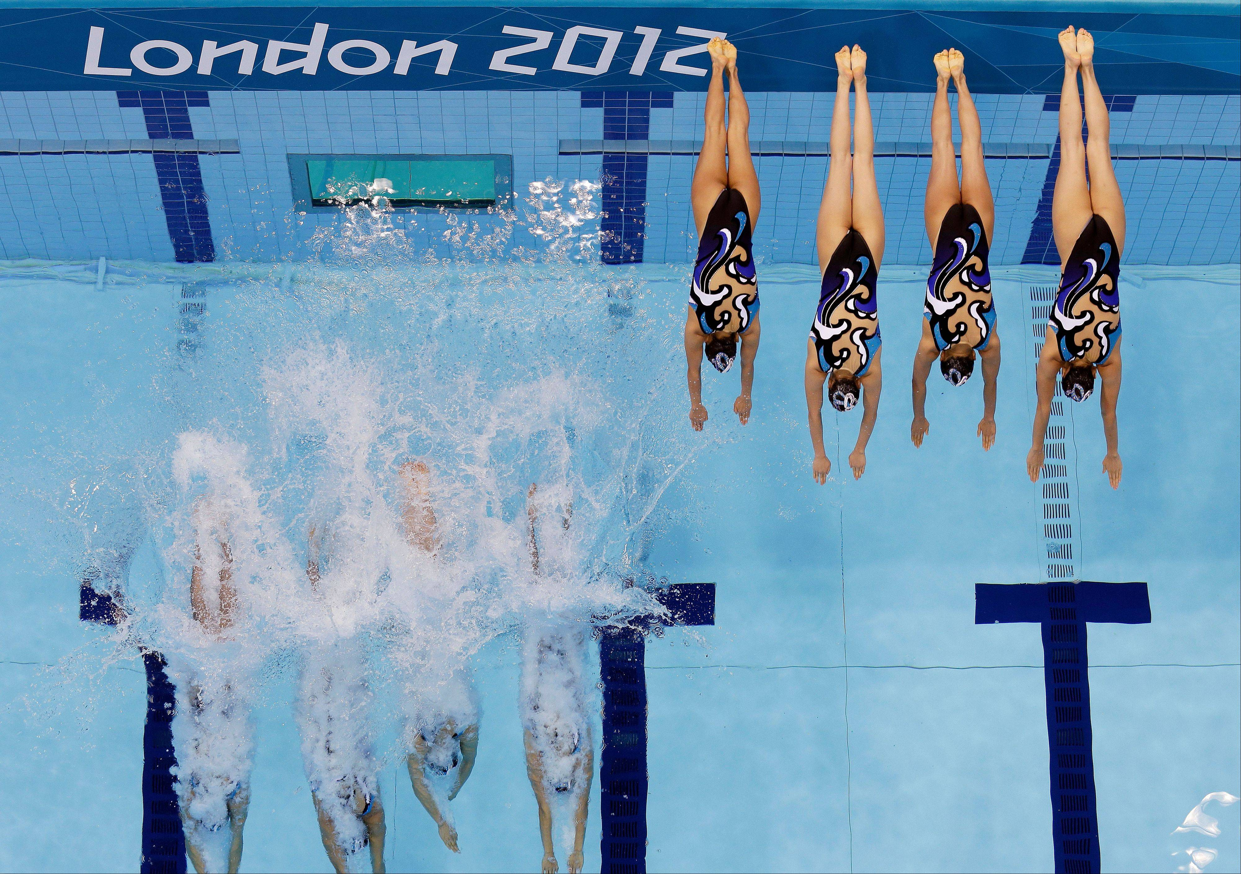 Japan's women's synchronized swimming team start their technical routine at the Aquatics Centre in the Olympic Park during the 2012 Summer Olympics in London, Thursday, Aug. 9, 2012.