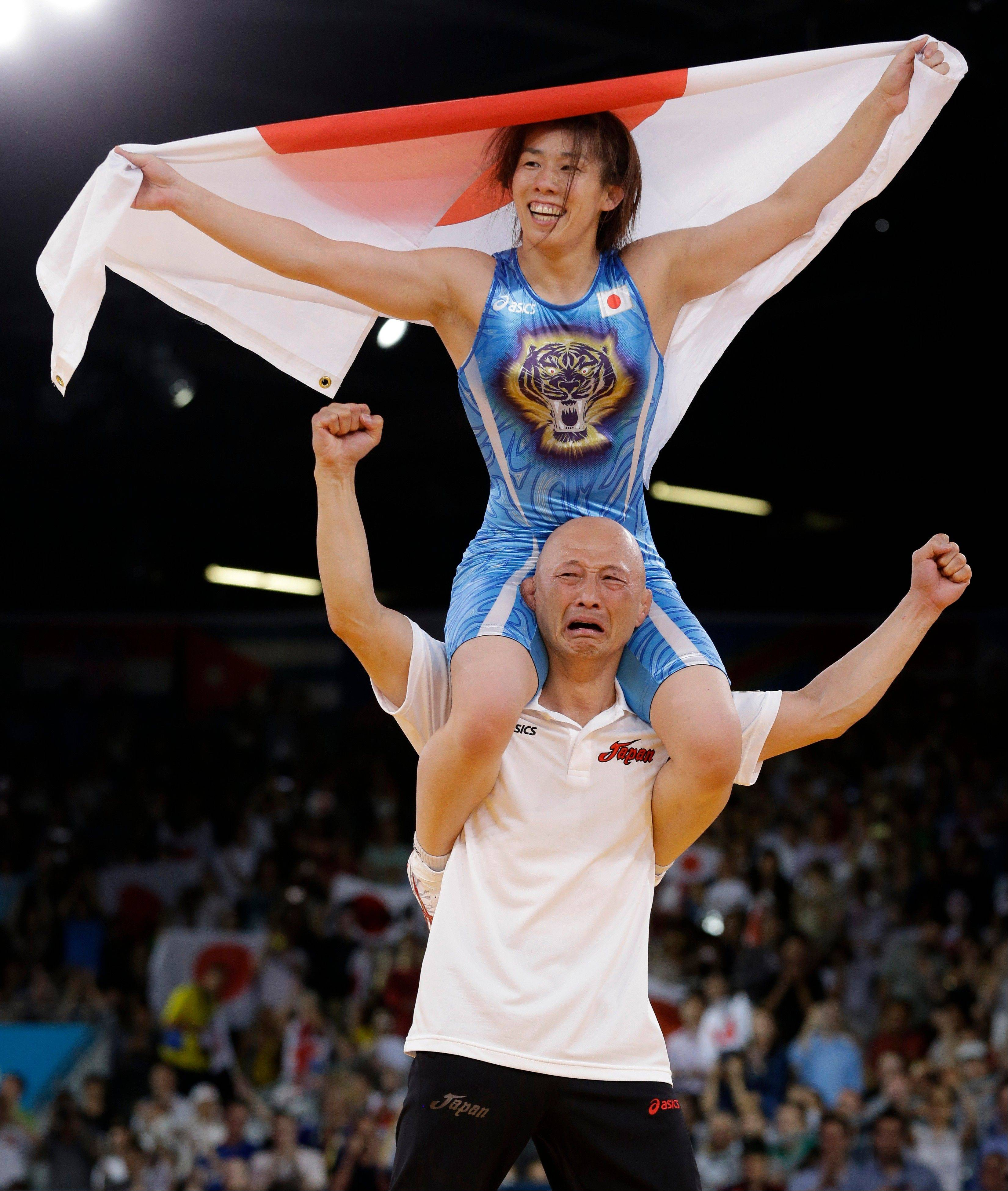 Saori Yoshida of Japan celebrates after she beat Tonya Lynn Verbeek of Canada for the gold medal during their 55-kg women's freestyle wrestling competition at the 2012 Summer Olympics, Thursday, Aug. 9, 2012, in London.