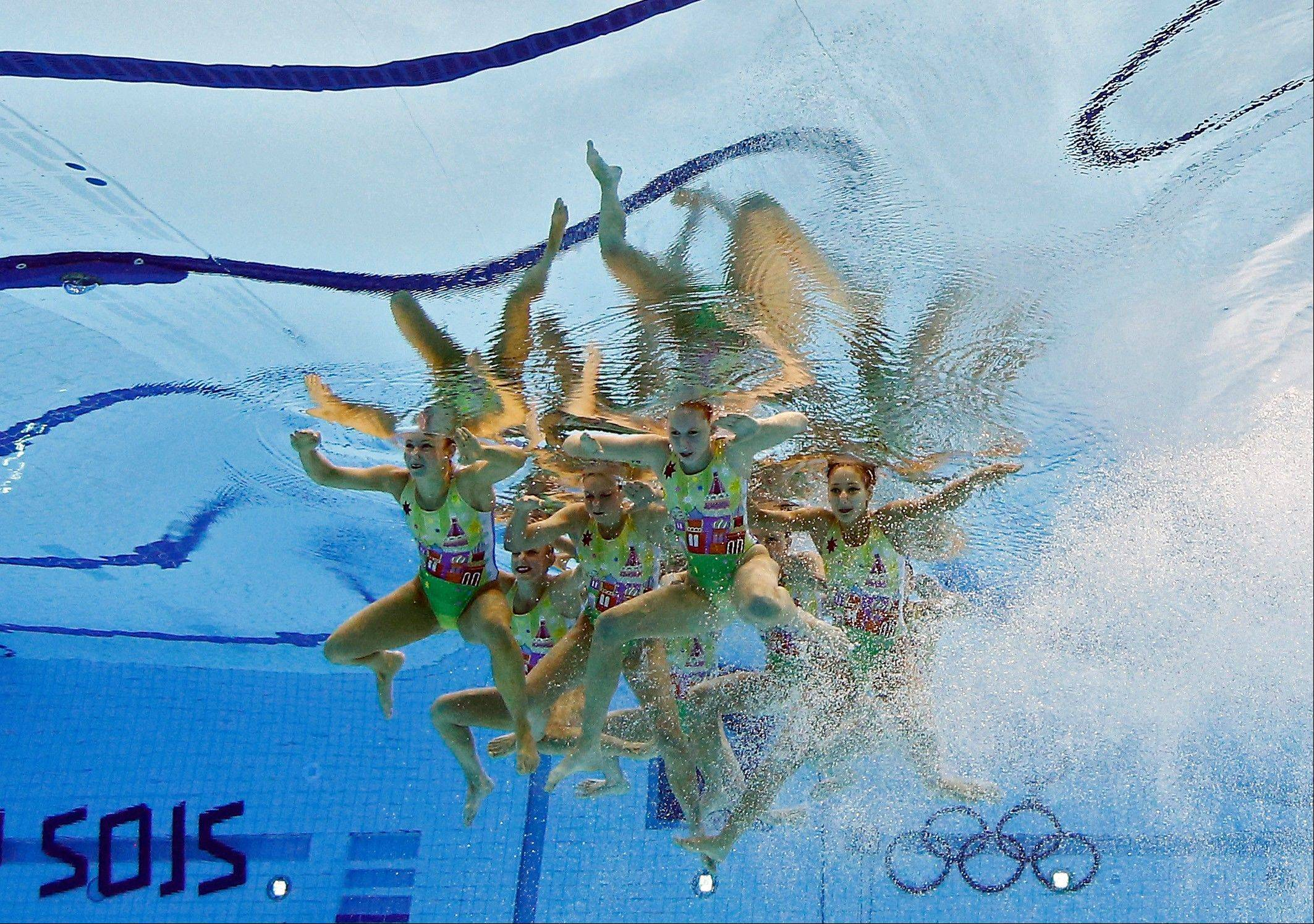 The team from Australia competes during the synchronized swimming team technical routine at the Aquatics Centre in the Olympic Park during the 2012 Summer Olympics in London, Thursday, Aug. 9, 2012.