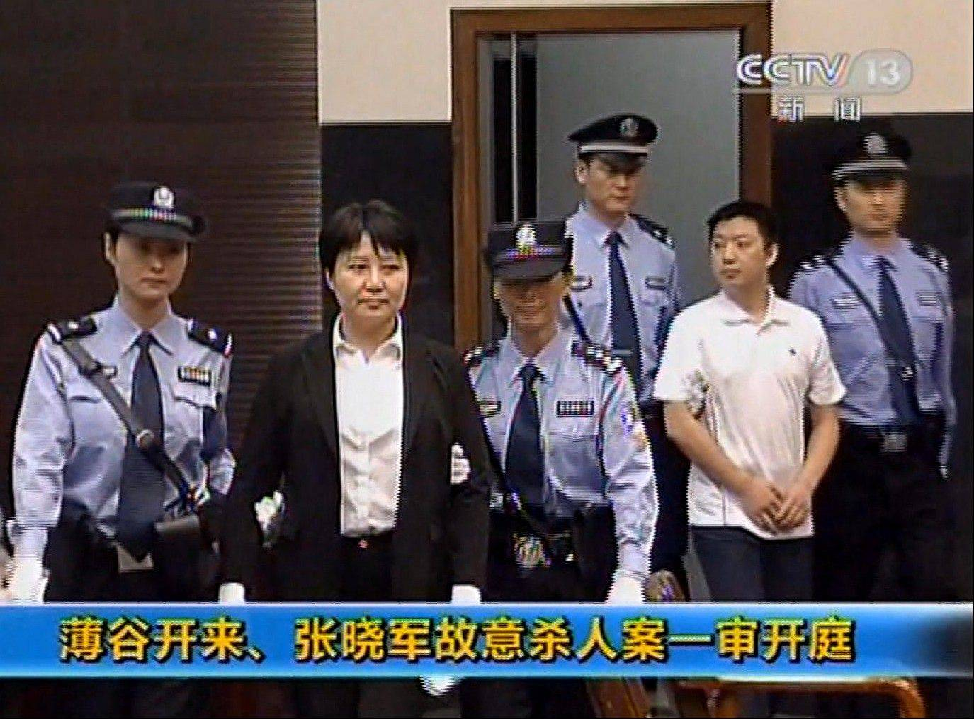 This video image taken from CCTV shows Gu Kailai, second left, the wife of disgraced politician Bo Xilai, being taken into the Intermediate People's Court in the eastern Chinese city of Hefei Thursday Aug. 9, 2012. According to testimony Thursday in one of China's highest-profile murder trials in years, Gu lured British businessman Neil Heywood to a hotel, where she got him drunk and fed him poison.