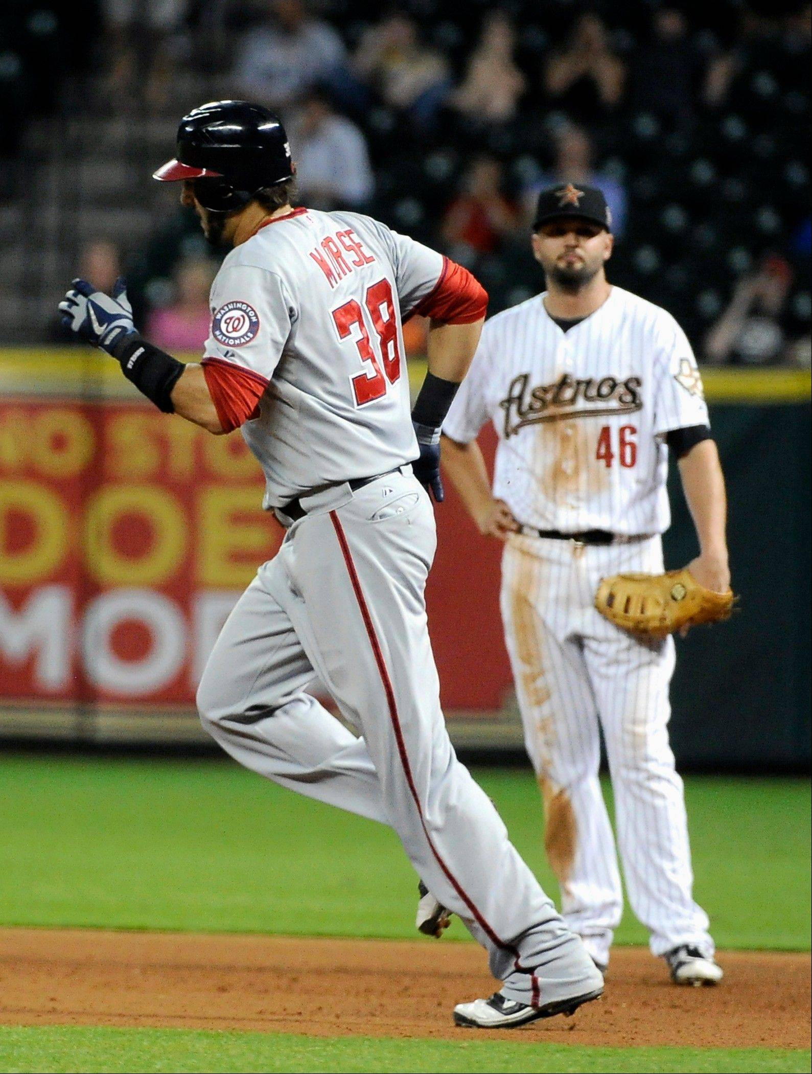 The Nationals' Michael Morse passes Astros first baseman Scott Moore on his way around the bases on a solo homer in the sixth inning Thursday in Houston.