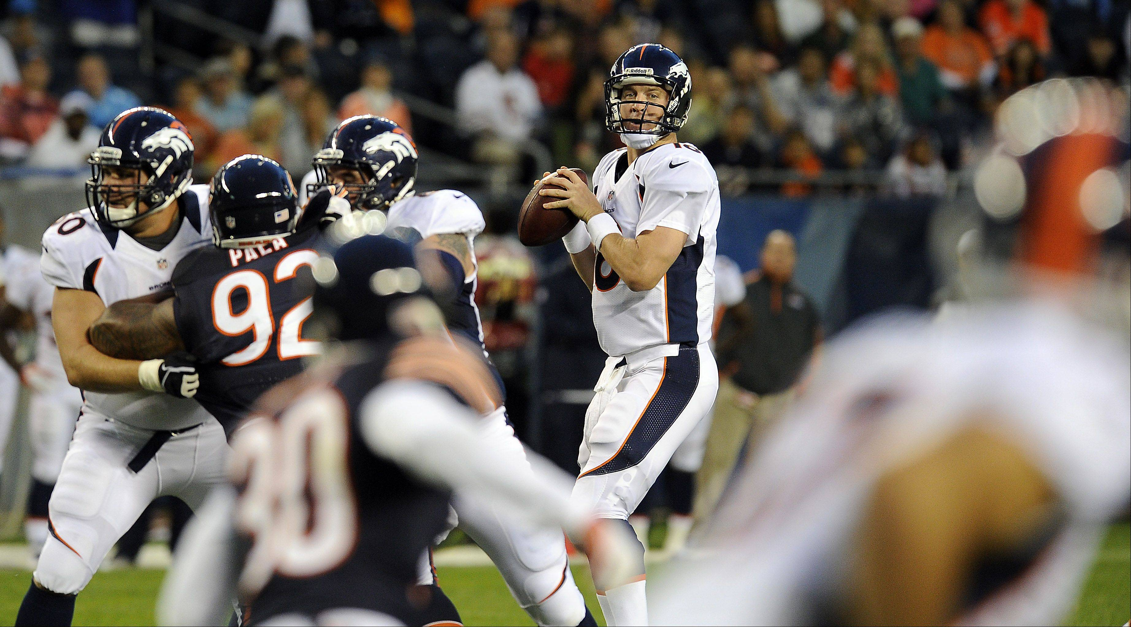 Denver Broncos quarterback Peyton Manning looks to pass during the first quarter.