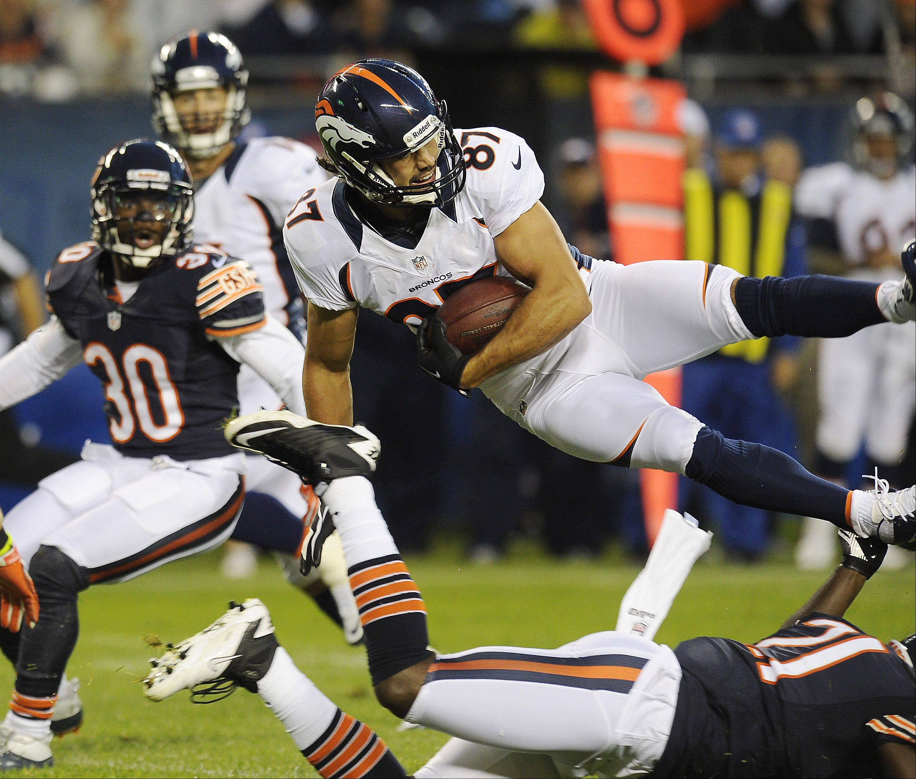 Major Wright upends Denver's Eric Decker in the first half.