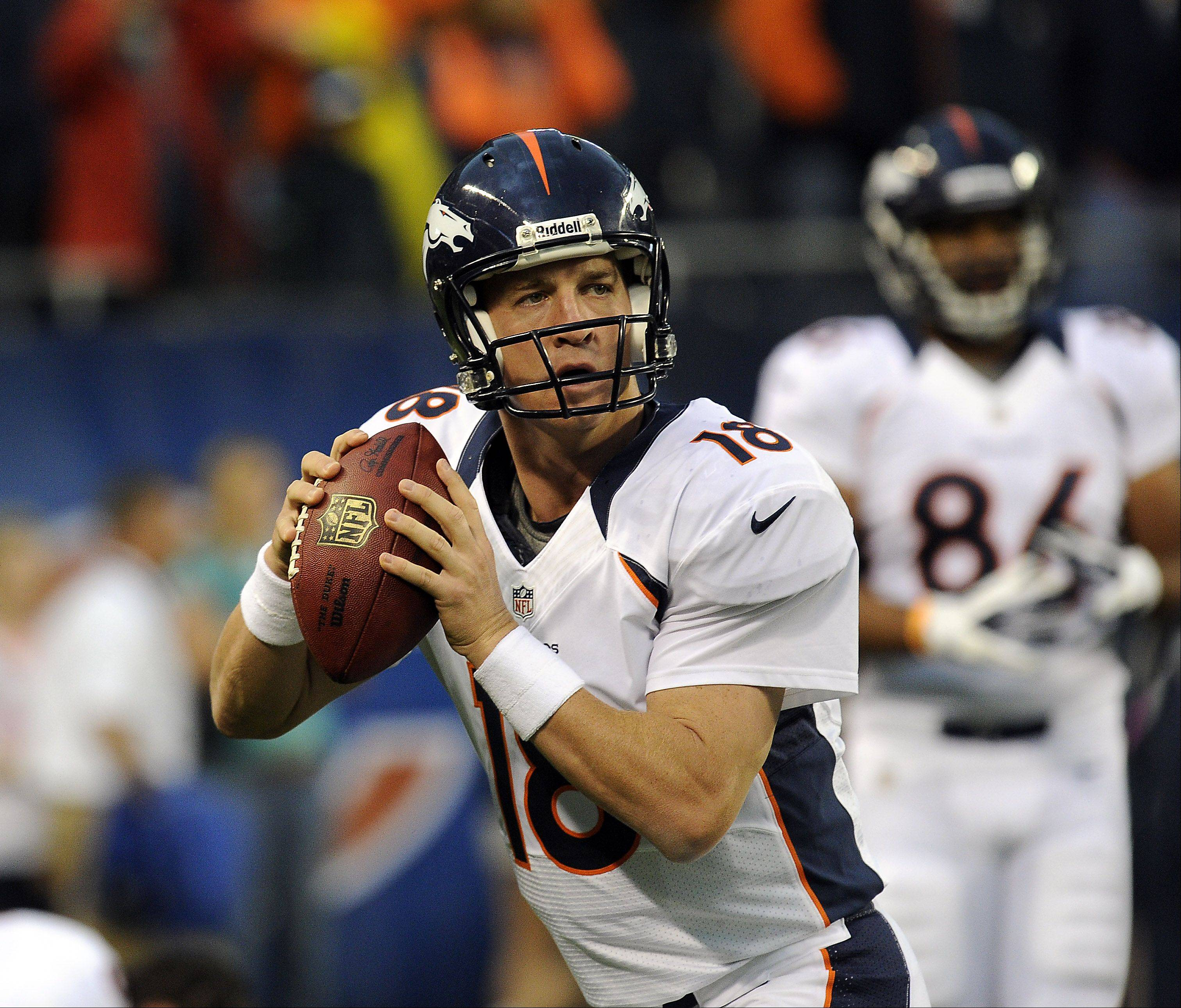 Denver Broncos quarterback Peyton Manning warms up before the game.