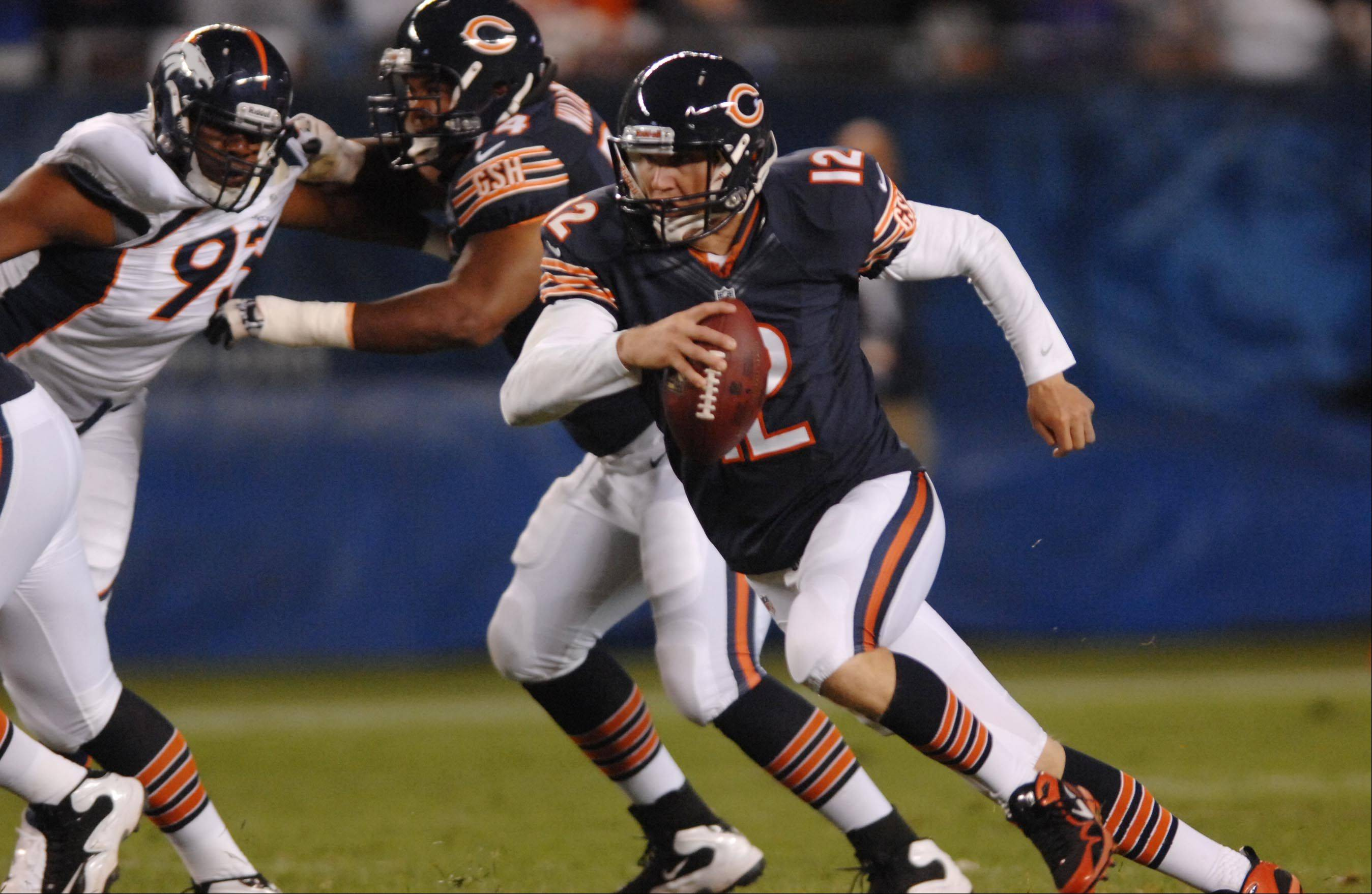 Chicago Bears quarterback Josh McCown takes off on a run.