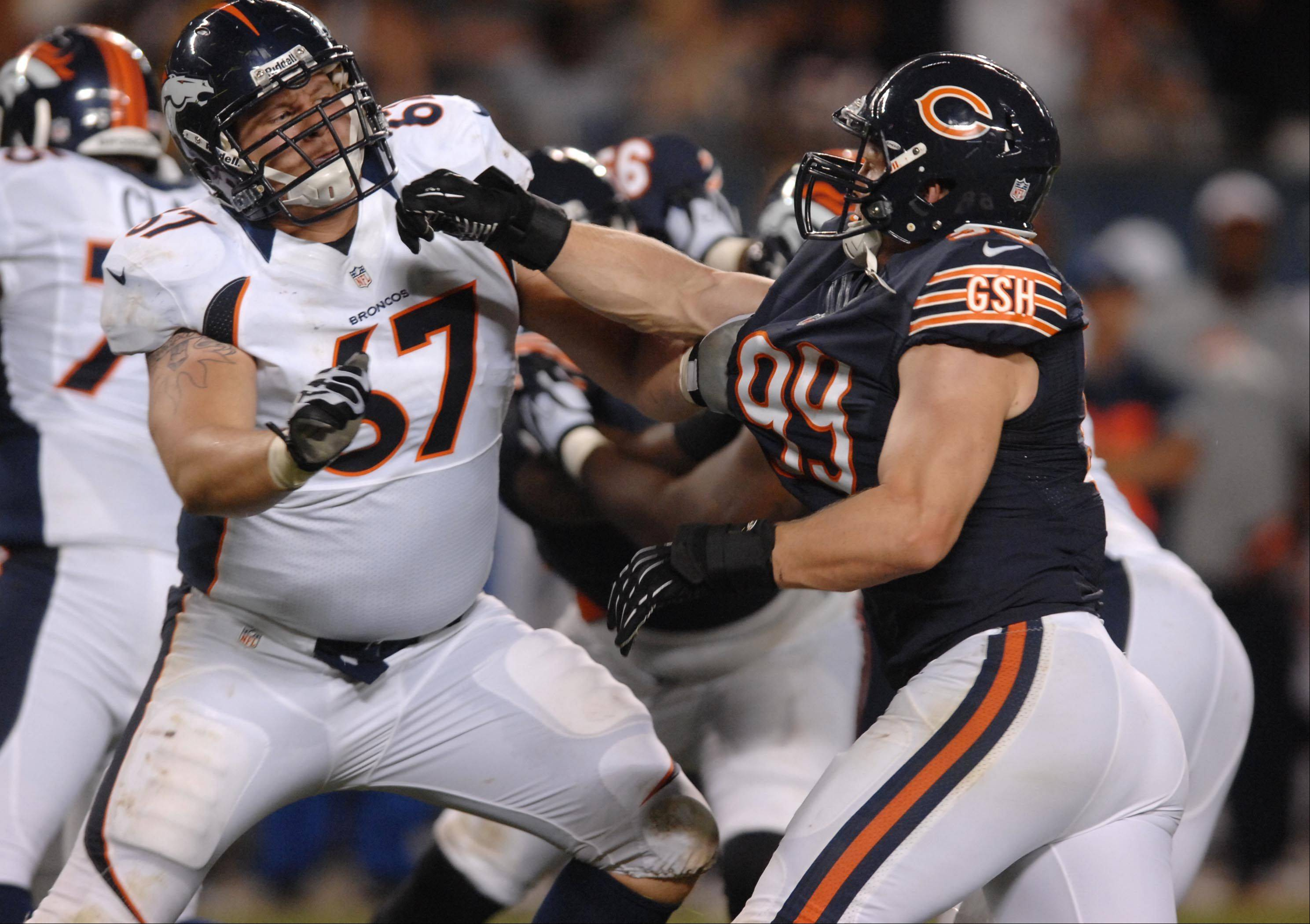 Chicago Bears defensive end Shea McClellin plays against Denver Broncos offensive tackle Adam Grant .