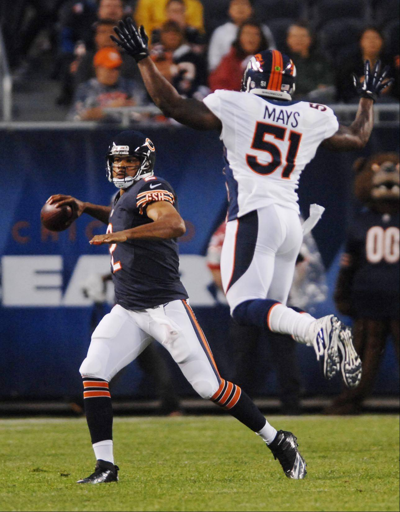 Denver Broncos linebacker Joe Mays pressures Chicago Bears quarterback Jason Campbell.