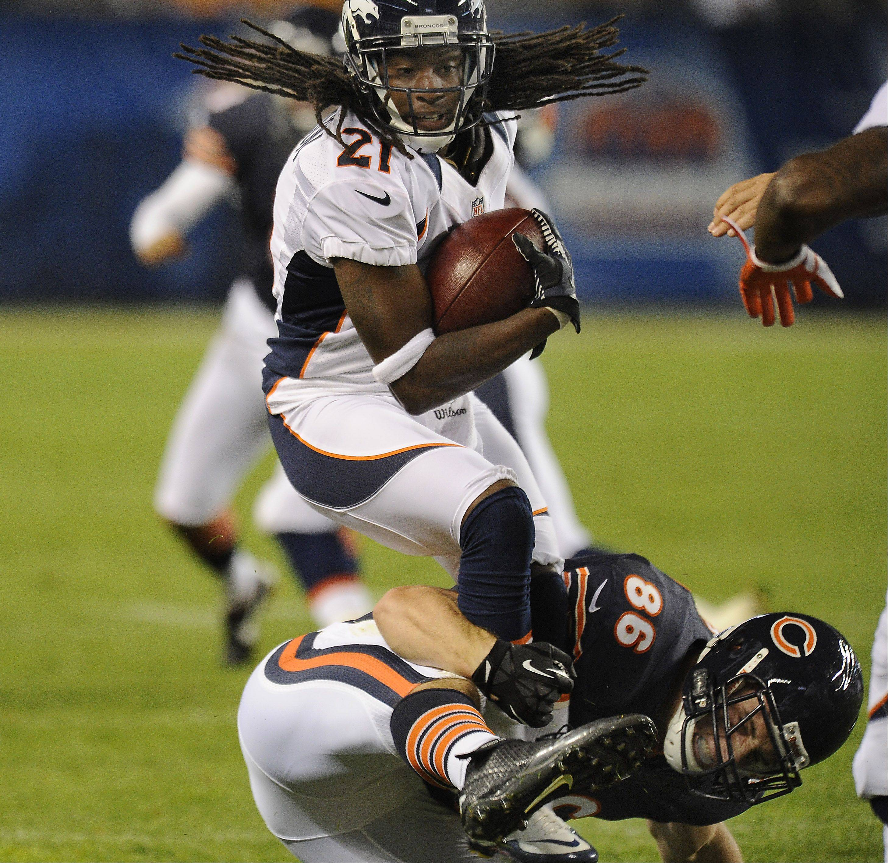 Chicago Bears Kyle Adams makes a one-legged tackle against Denver Bronco Syd'Quan Thompson in the first half.
