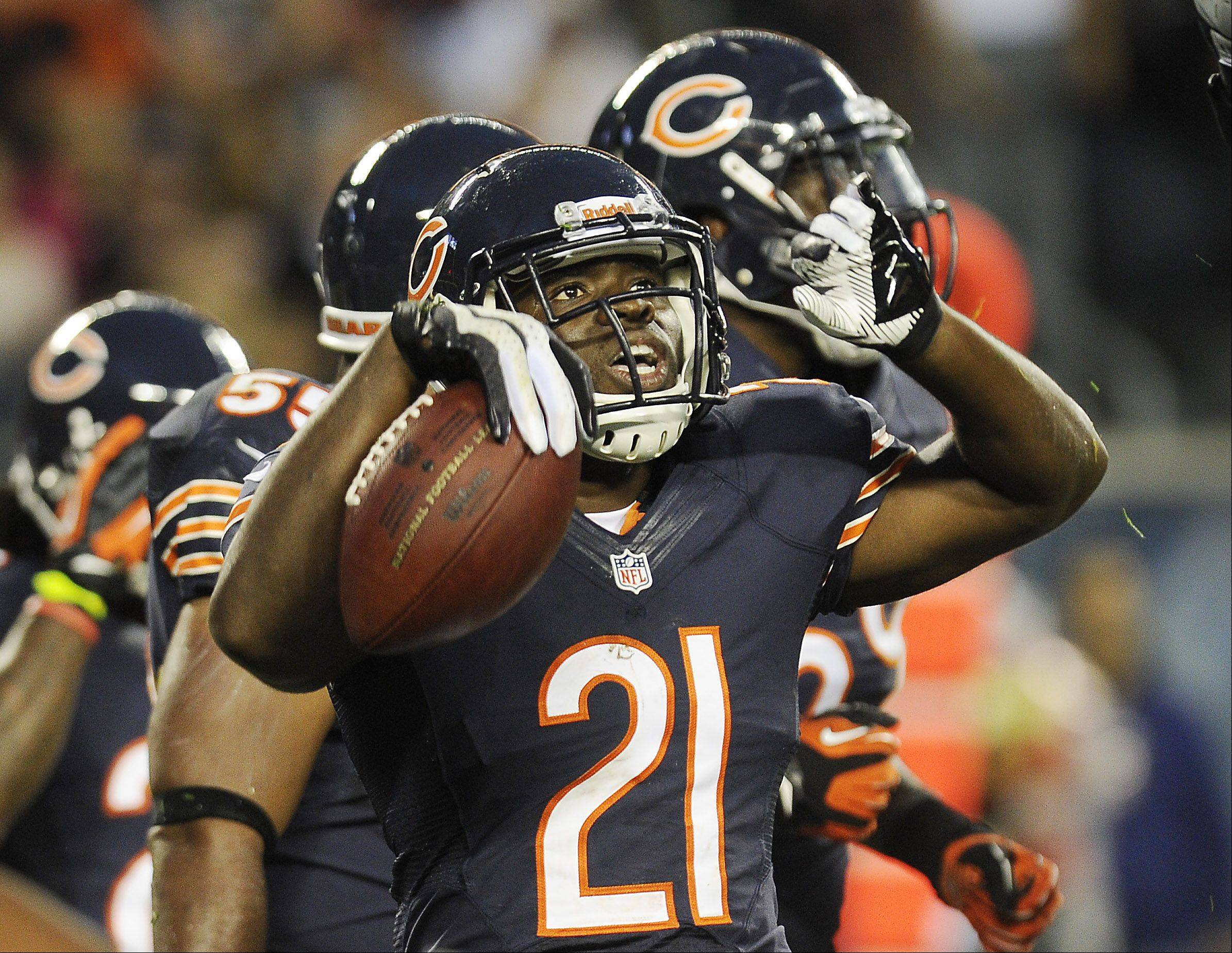 Chicago Bears' Major Wright celebrates an interception during the first quarter .