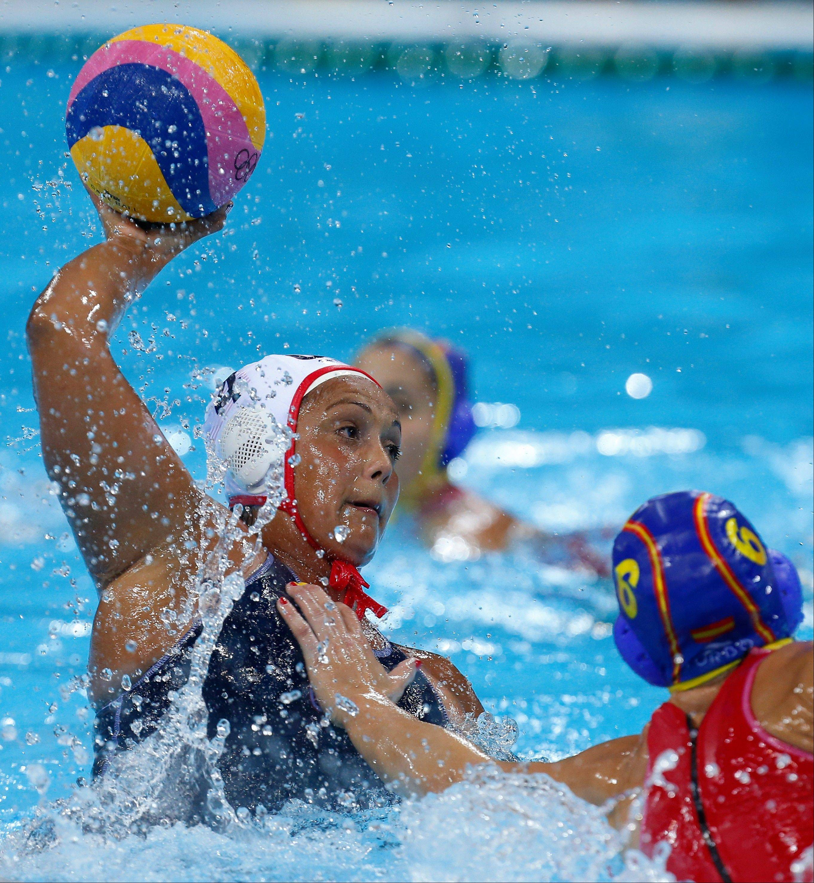 Brenda Villa of the United States shoots at goal during Thursday the women's water polo gold medal match against Spain.