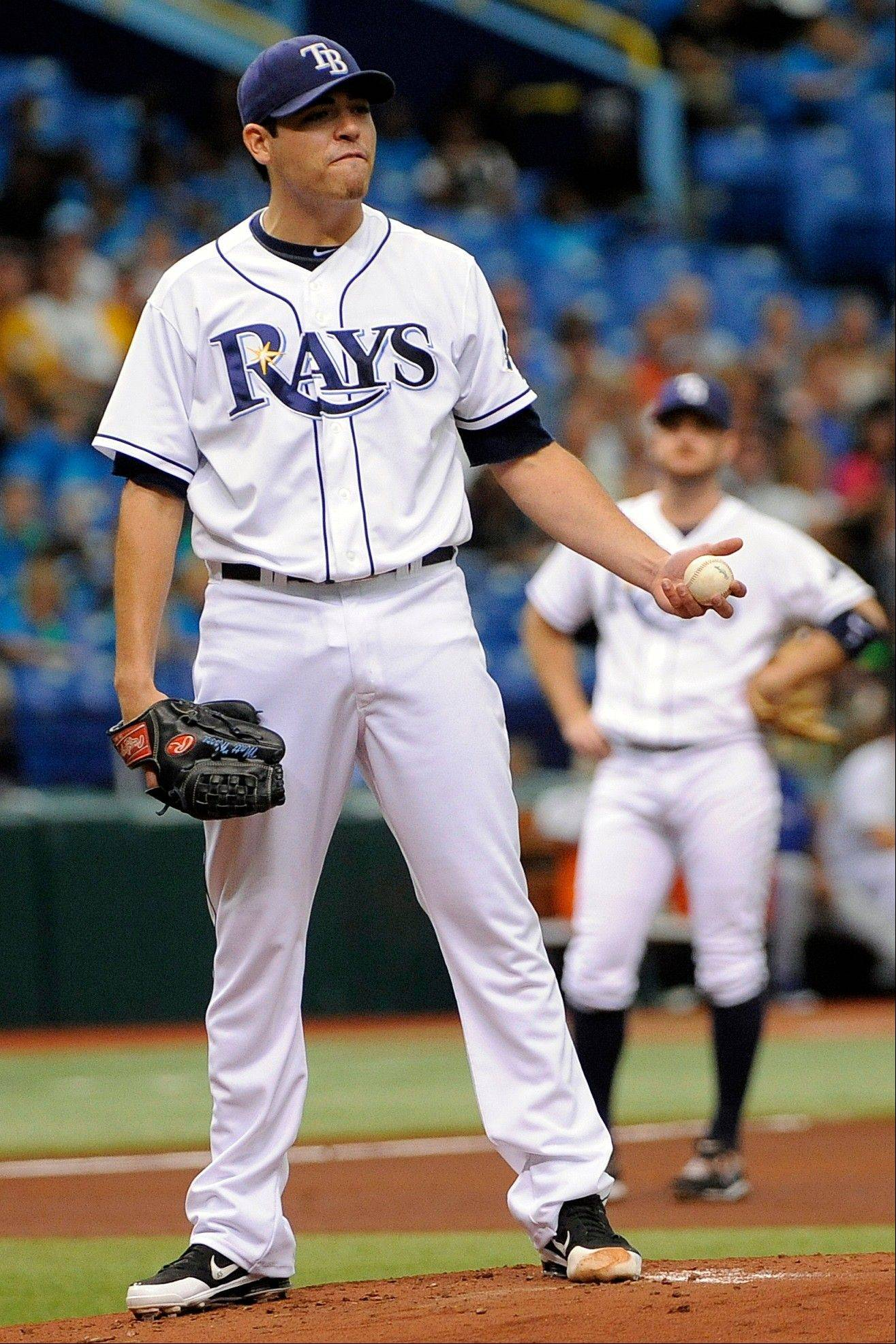 Tampa Bay Rays starting pitcher Matt Moore reacts Thursday after being called for a balk during the first inning.