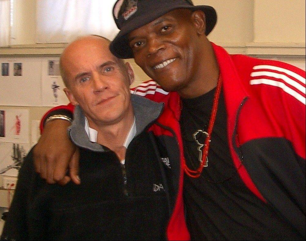 "Nick Gillard, left, stunt coordinator for the ""Star Wars"" prequels, poses with actor Samuel L. Jackson, who starred in the films. Gillard will be teaching lightsaber fighting moves at the Wizard World Chicago Comic Con in Rosemont."