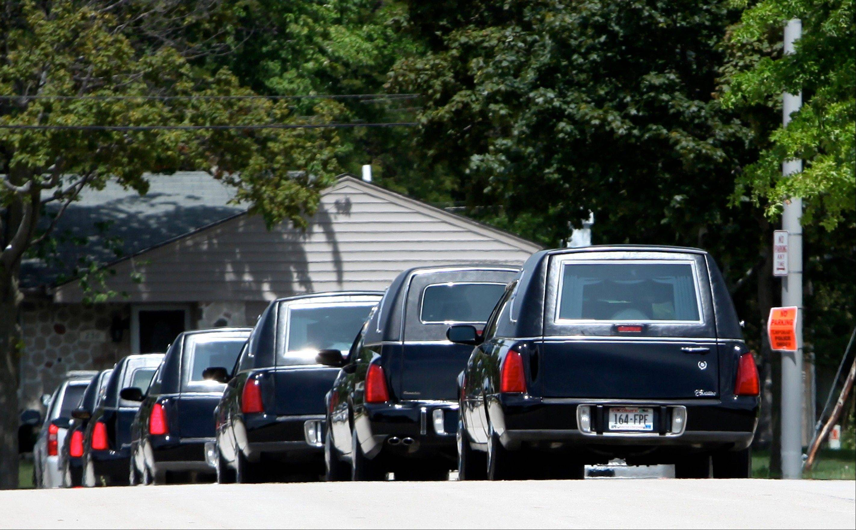 Associated Press Six hearses carrying the deceased leave the Oak Creek High School after the funeral and memorial service Friday for the six victims of the Sikh Temple of Wisconsin mass shooting in Oak Creek, Wis.