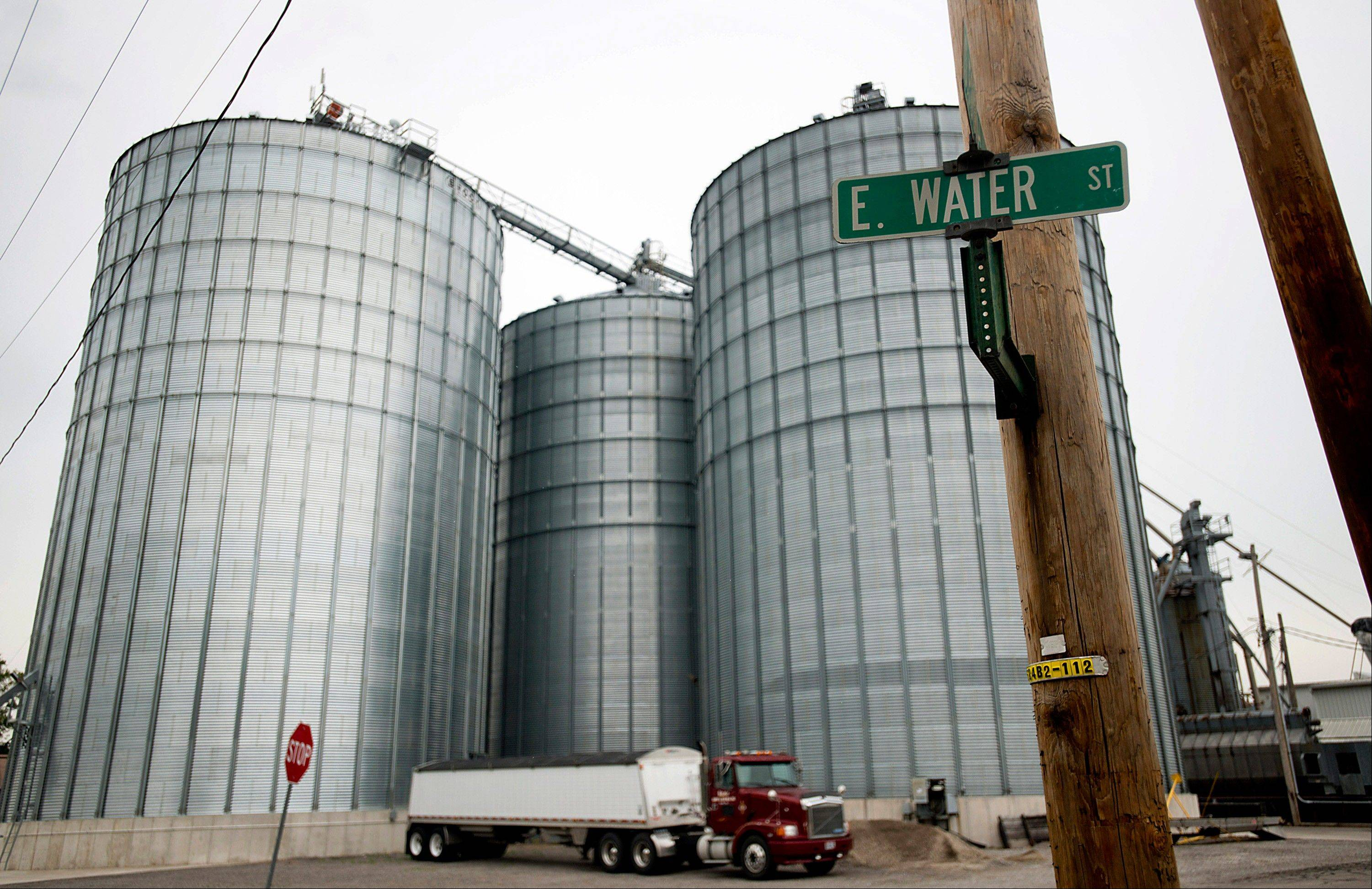 A truck sits parked outside of grain bins Thursday at Kahle Supply and Feed Mill Inc.'s facility in Kalida, Ohio.