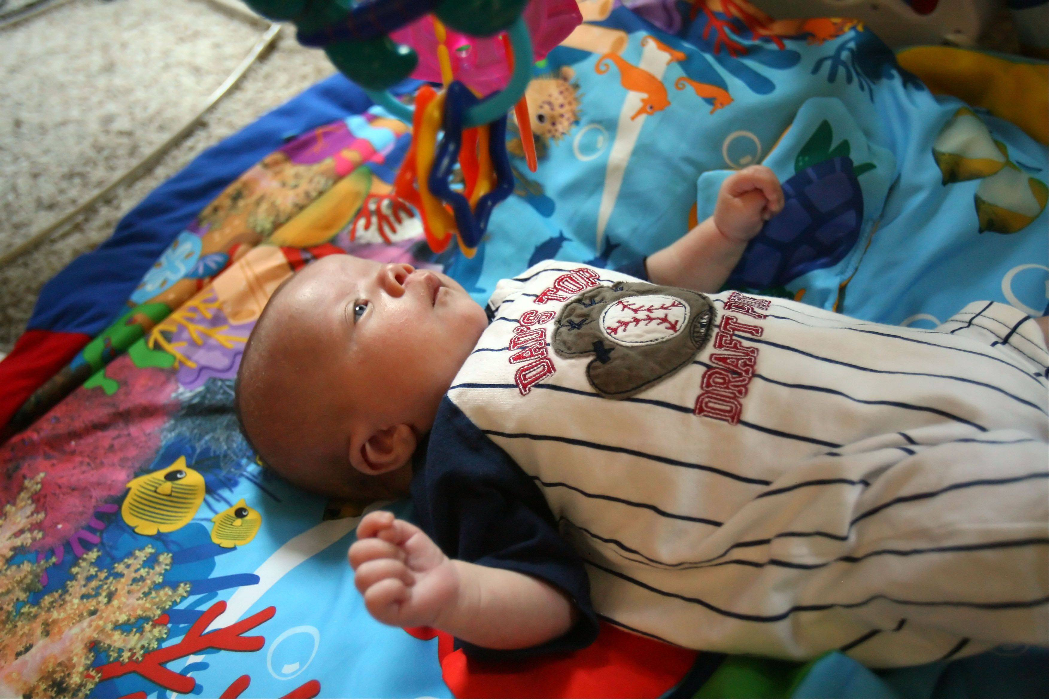 Katie Thorstenson's 2-month-old baby, Drew, does some mat time at their home in Wauconda. Drew has Noonan Syndrome.