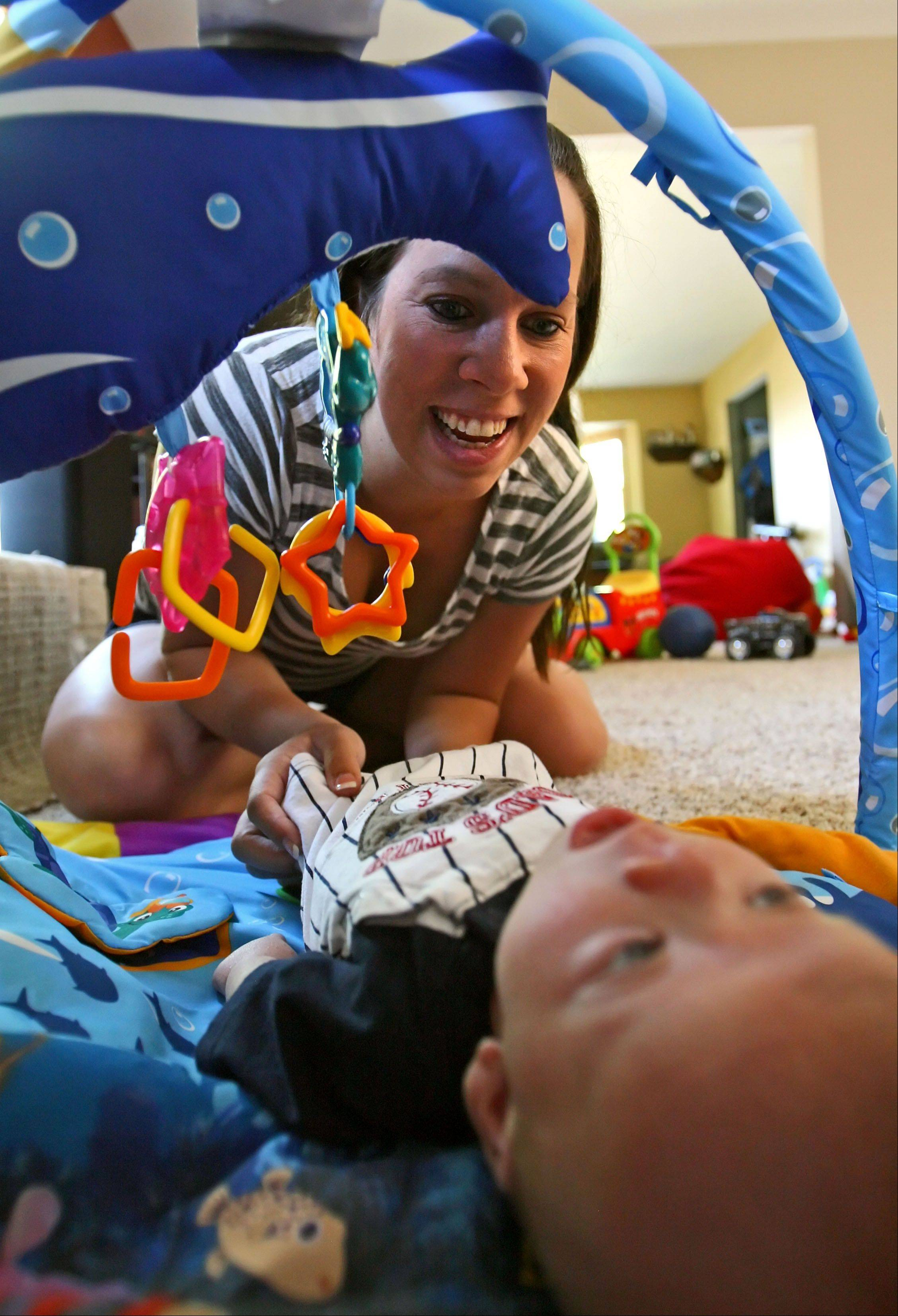 Katie Thorstenson of Wauconda plays with her 2-month-old baby, Drew, who has Noonan Syndrome.