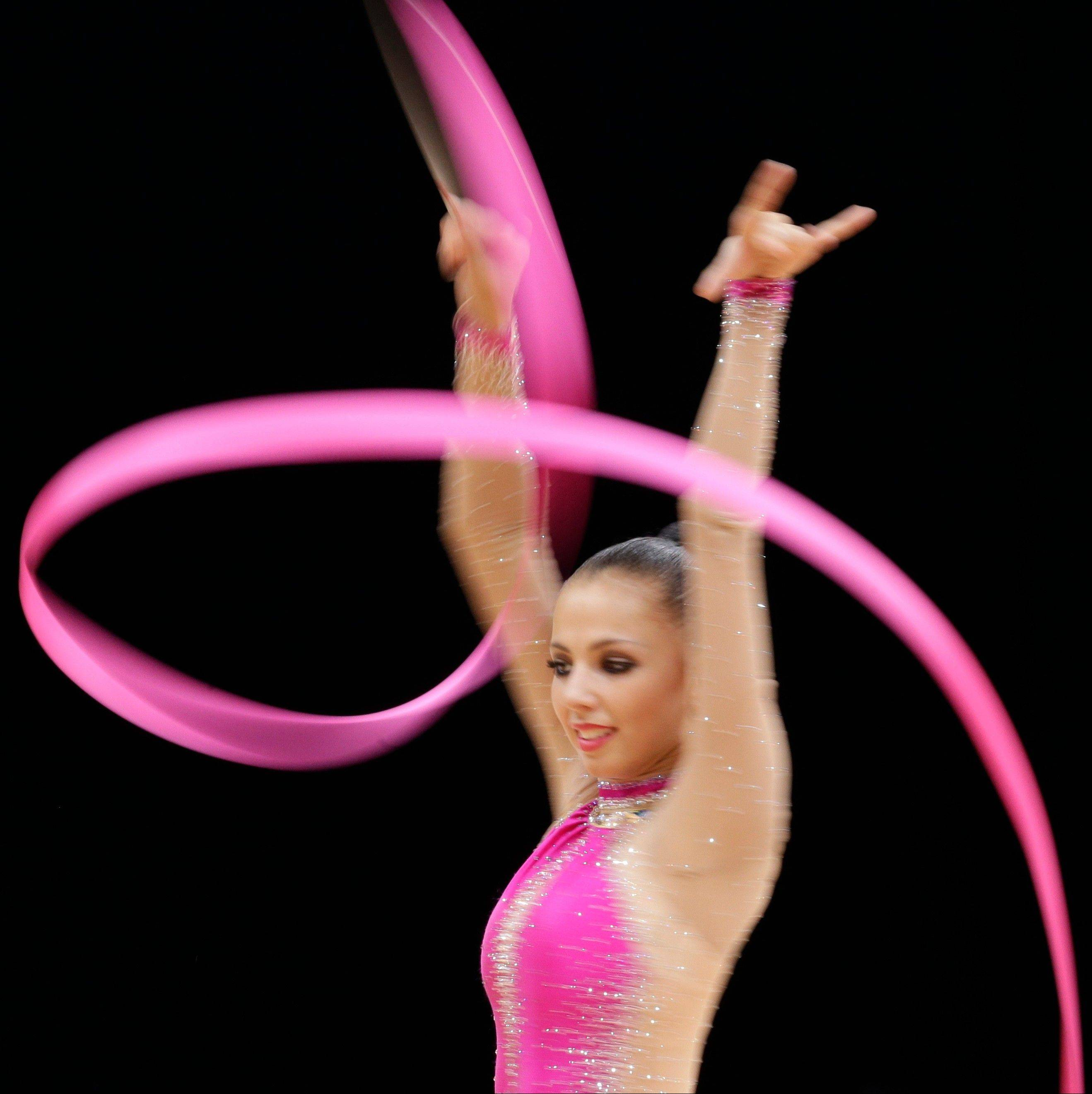 Russia's Daria Dmitrieva performs during the rhythmic gymnastics individual all-around qualifications at the 2012 Summer Olympics, Friday, Aug. 10, 2012, in London.