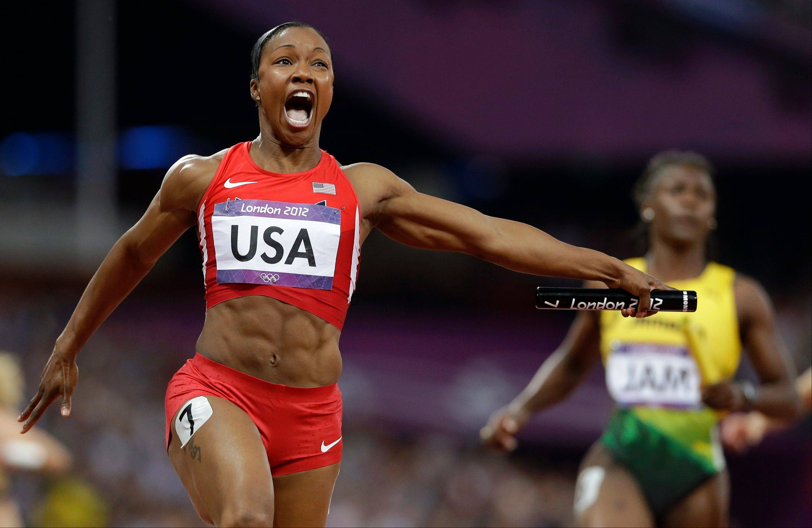 United States' Carmelita Jeter reacts as she crosses the finish line to win the women's 4 x 100-meter relay during the athletics in the Olympic Stadium at the 2012 Summer Olympics, London, Friday, Aug. 10, 2012. The United States relay team set a new world record with a time of 40.82 seconds.