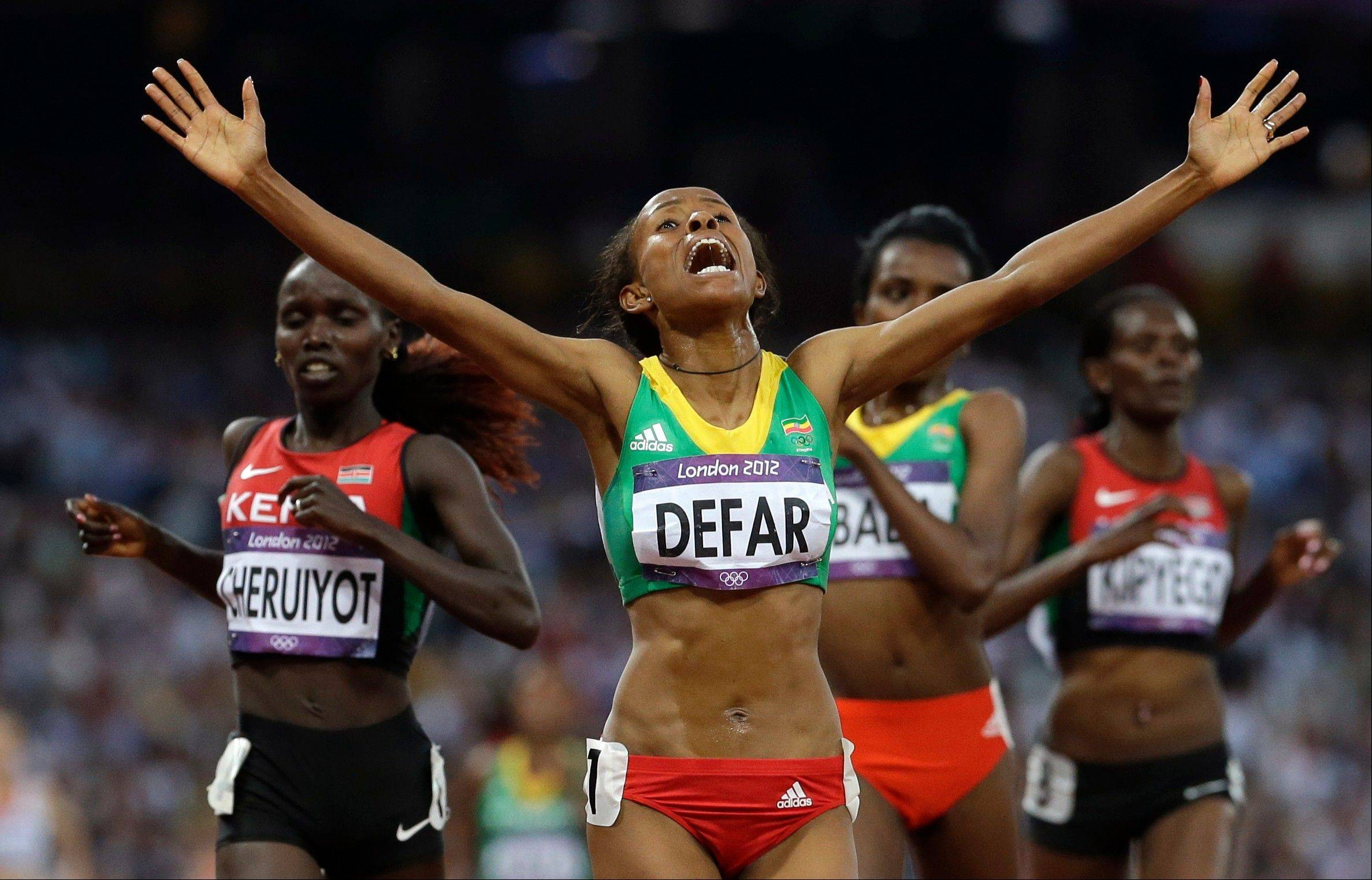 Ethiopia's Meseret Defar reacts as she crosses the finish line to win the 5000-meter final during the athletics in the Olympic Stadium at the 2012 Summer Olympics, London, Friday, Aug. 10, 2012.