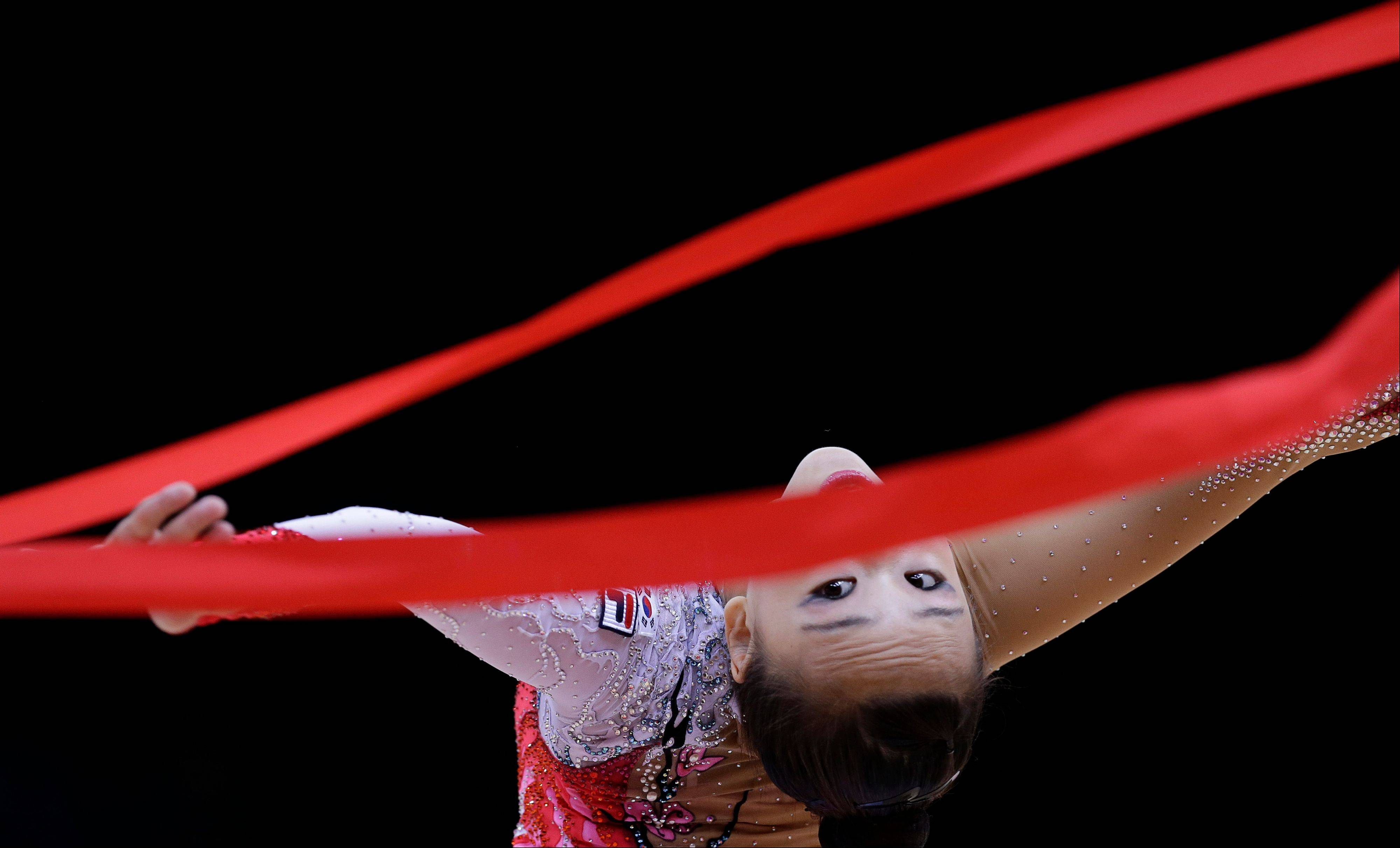 South Korea's Son Yeon-jae performs during the rhythmic gymnastics individual all-around qualifications at the 2012 Summer Olympics, Friday, Aug. 10, 2012, in London.