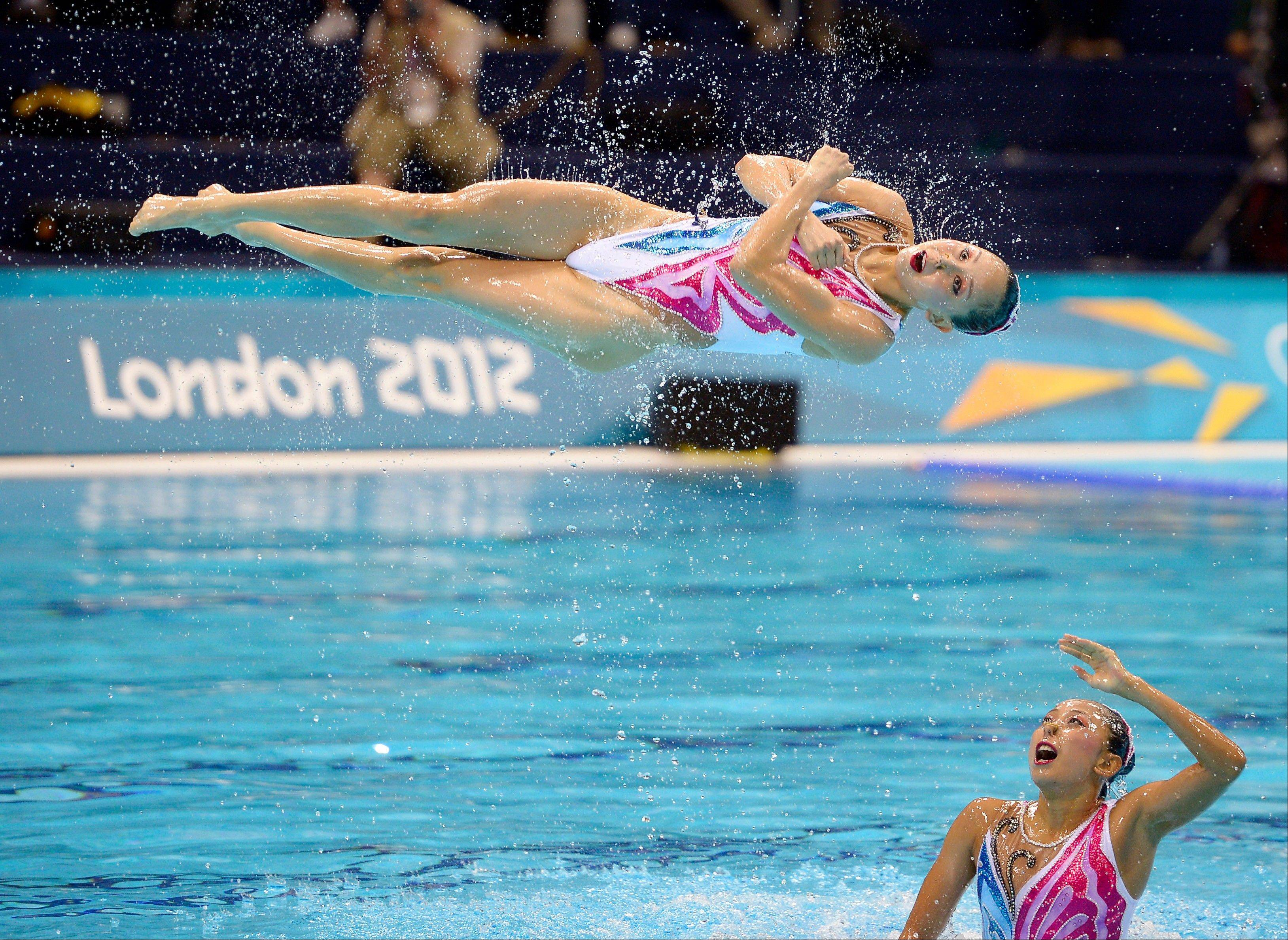 The team from China competes during the synchronized swimming team free routine final at the Aquatics Centre in the Olympic Park during the 2012 Summer Olympics in London, Friday, Aug. 10, 2012. China took the silver medal in the event.