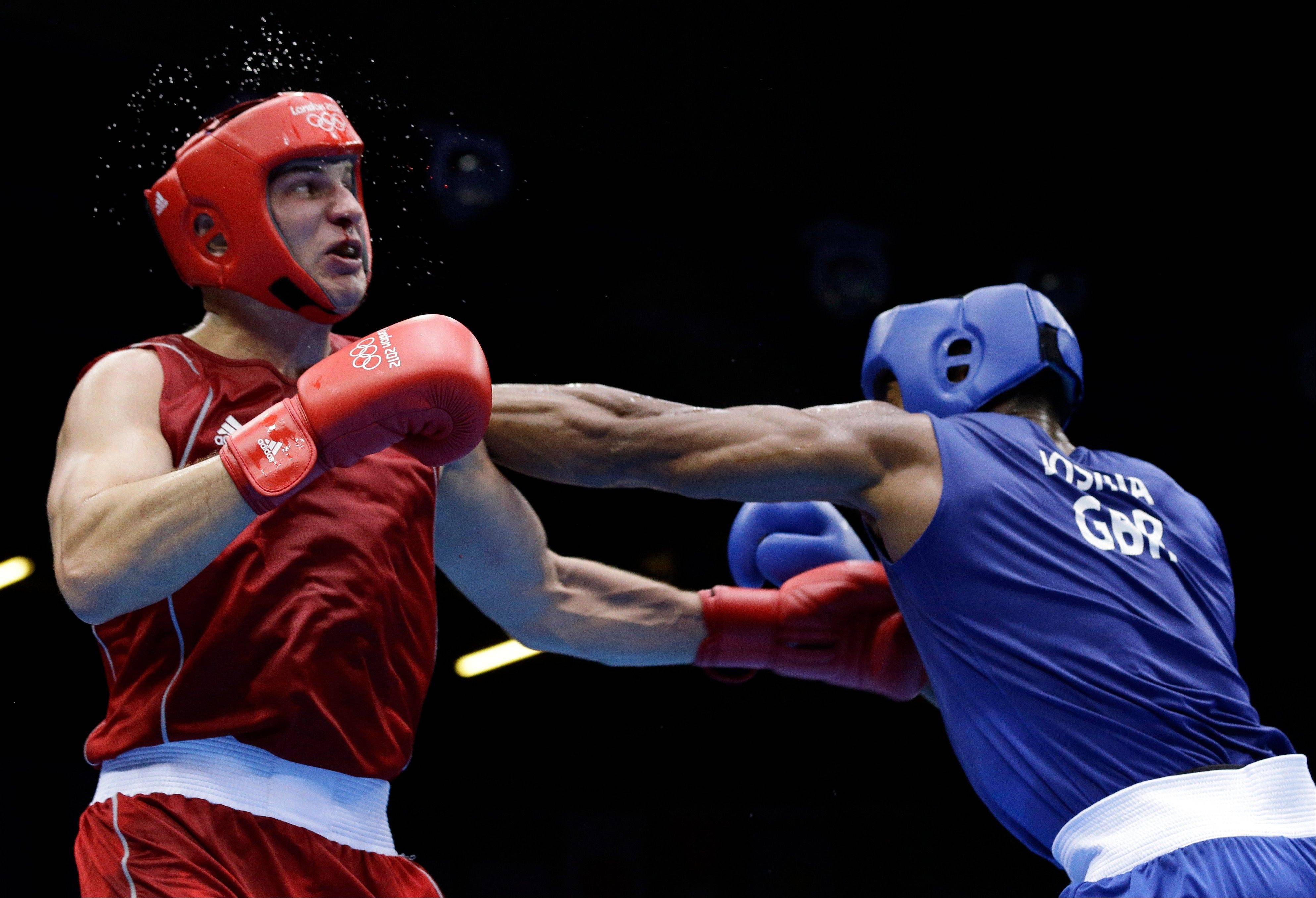 Kazakhstan's Ivan Dychko, left, fights Britain's Anthony Joshua in a super heavyweight over 91-kg semifinal boxing match at the 2012 Summer Olympics, Friday, Aug. 10, 2012, in London.