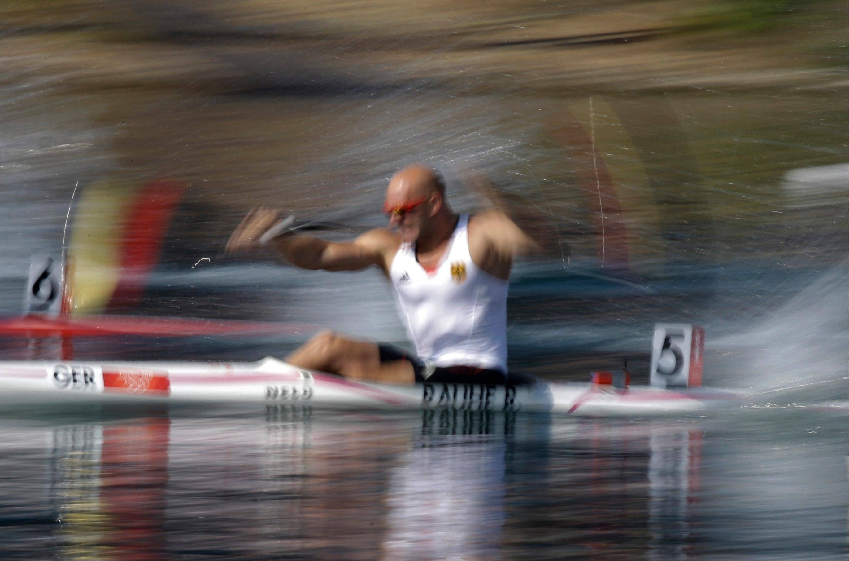 Germany's Ronald Rahue paddles in a men's kayak single 200m heat in Eton Dorney, near Windsor, England, at the 2012 Summer Olympics, Friday, Aug. 10, 2012.