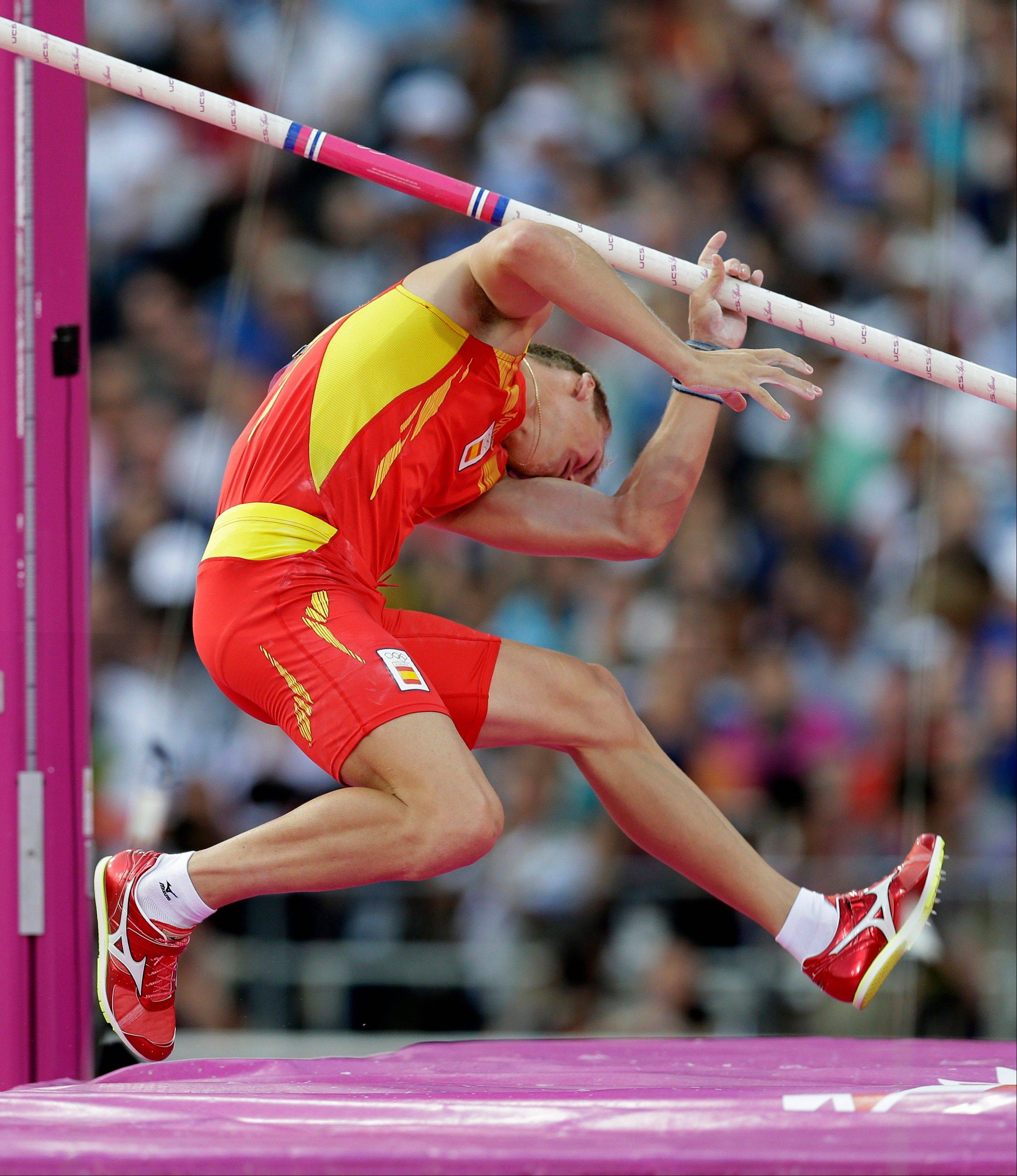 Spain's Igor Bychkov is hit by his pole as he fails to launch himself in the men's pole vault final during the athletics in the Olympic Stadium at the 2012 Summer Olympics, London, Friday, Aug. 10, 2012.
