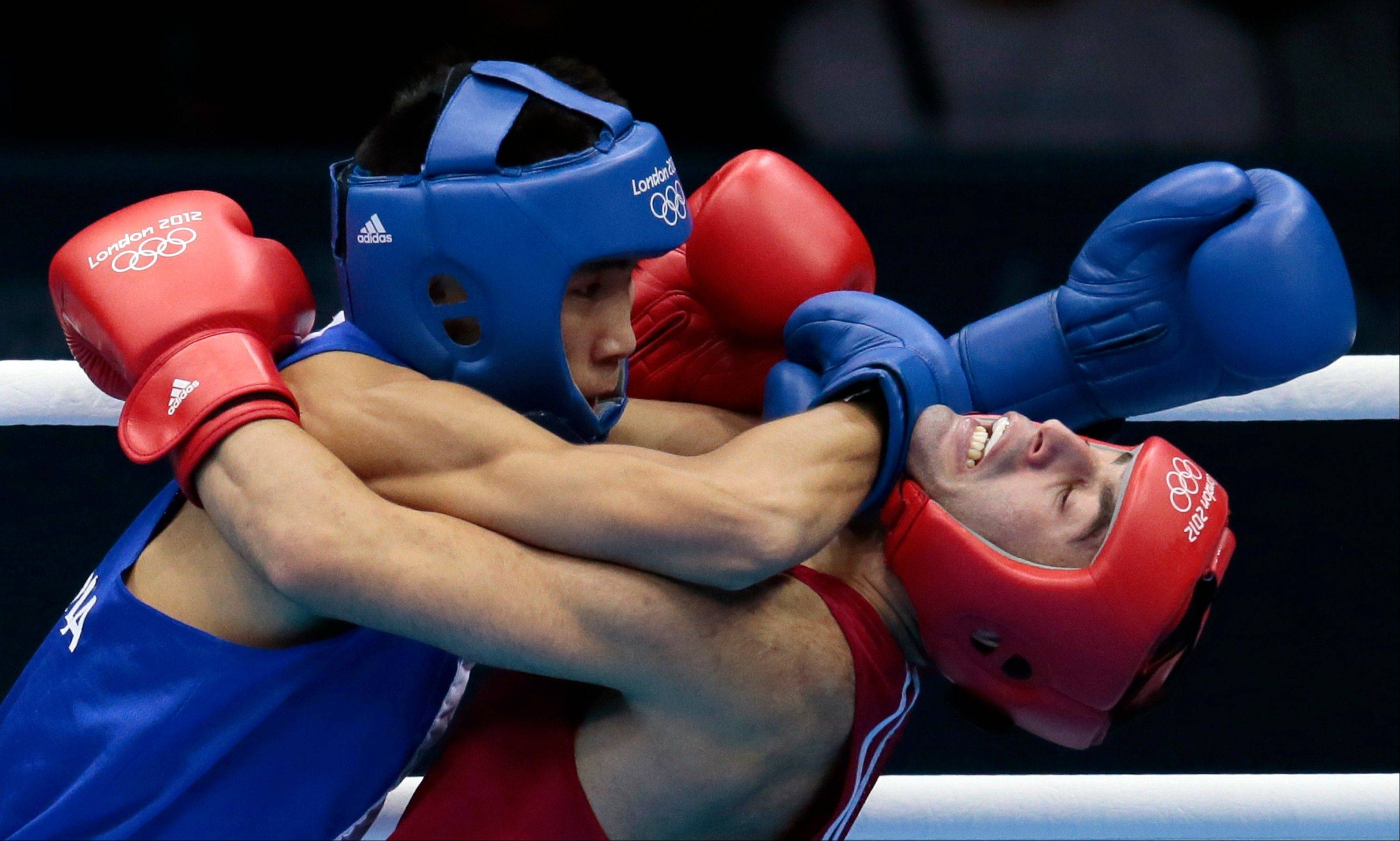 Russia's Misha Aloian, right, fights Mongolia's Tugstsogt Nyambayar, during their men's flyweight 52-kg semifinal boxing match at the 2012 Summer Olympics, Friday, Aug. 10, 2012, in London.