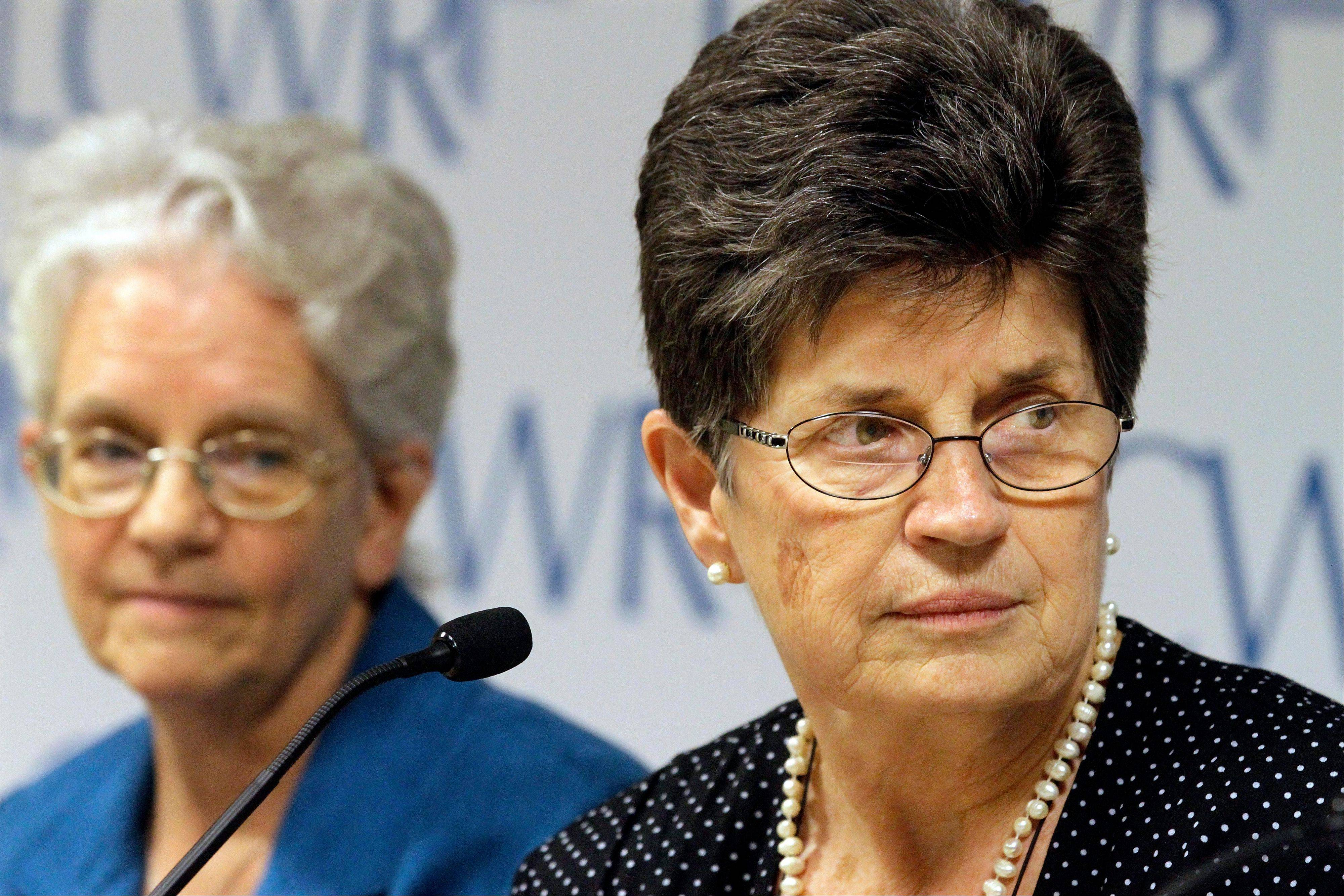Outgoing President of The Leadership Conference of Women Religious Sister Pat Farrell, right, and president elect Sister Florence Deacon, left, listen to questions from reporters Friday.