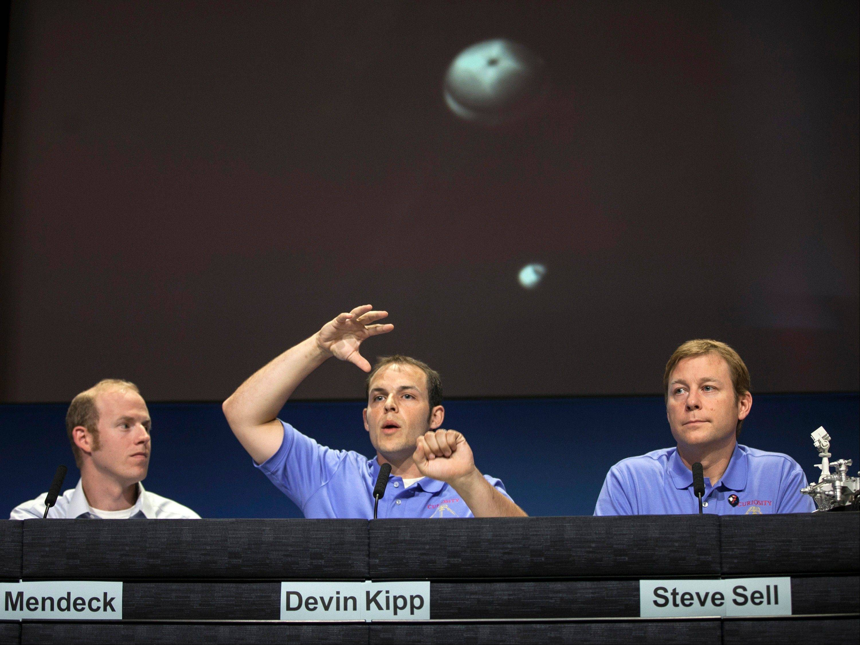 Gavin Mendeck, member of MSL entry, descent and landing team, NASA Johnson Space Center, Houston, Devin Kipp, member of MSL entry, descent and landing team, JPL and Steve Sell, member of MSL entry, descent and landing team, JPL, describe the timing of the MSL parachute deployment during Curiosity Mars landing.