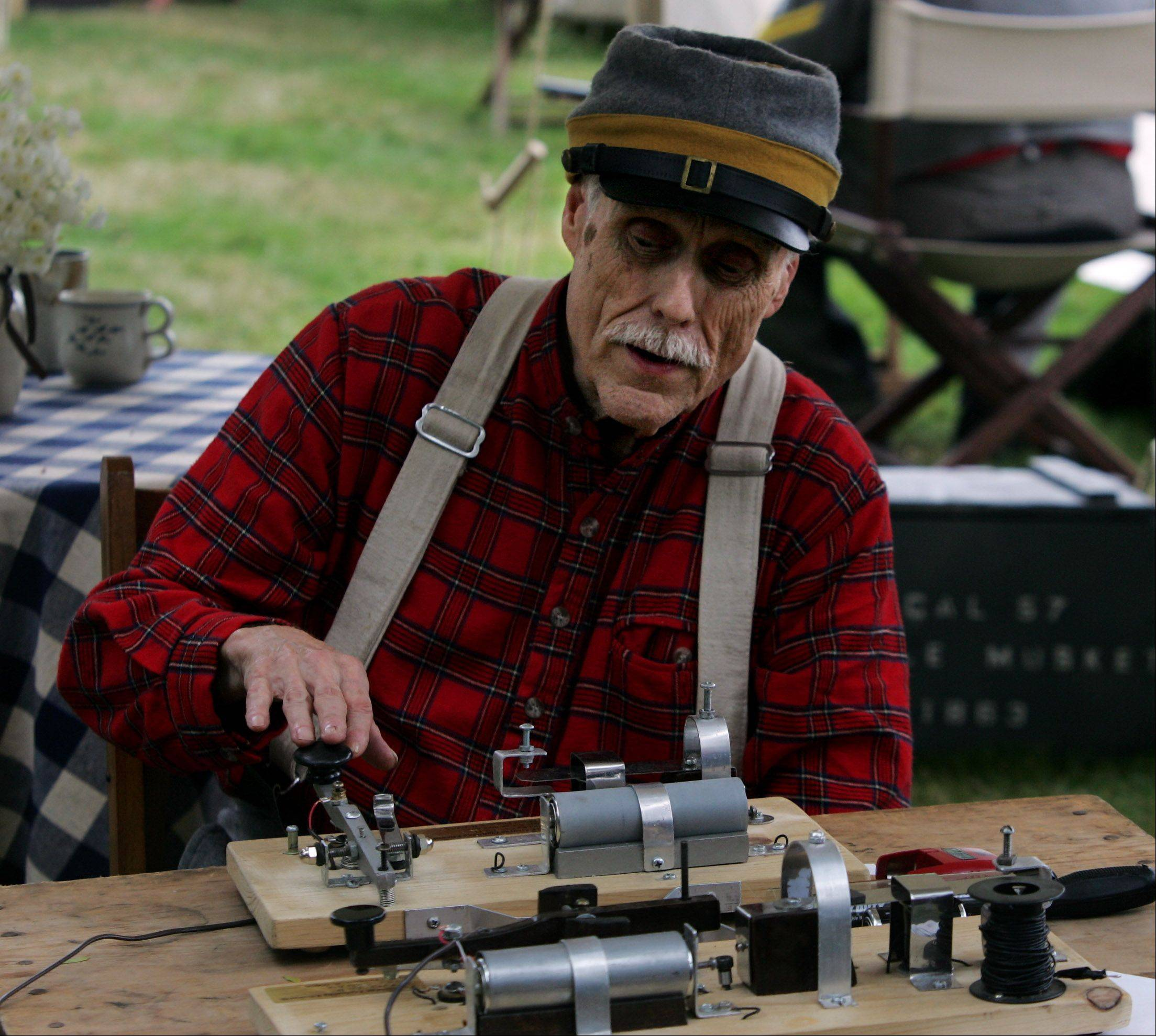 "Jim Rush of Mount Prospect demonstrates the telegraph used during the Civil War during last year's Annual Lake Villa Civil War Days at the Lehmann Mansion. Rush was acting as George ""Lightning"" Ellsworth who was a famous telegrapher of the Confederate Morgan's Raiders."