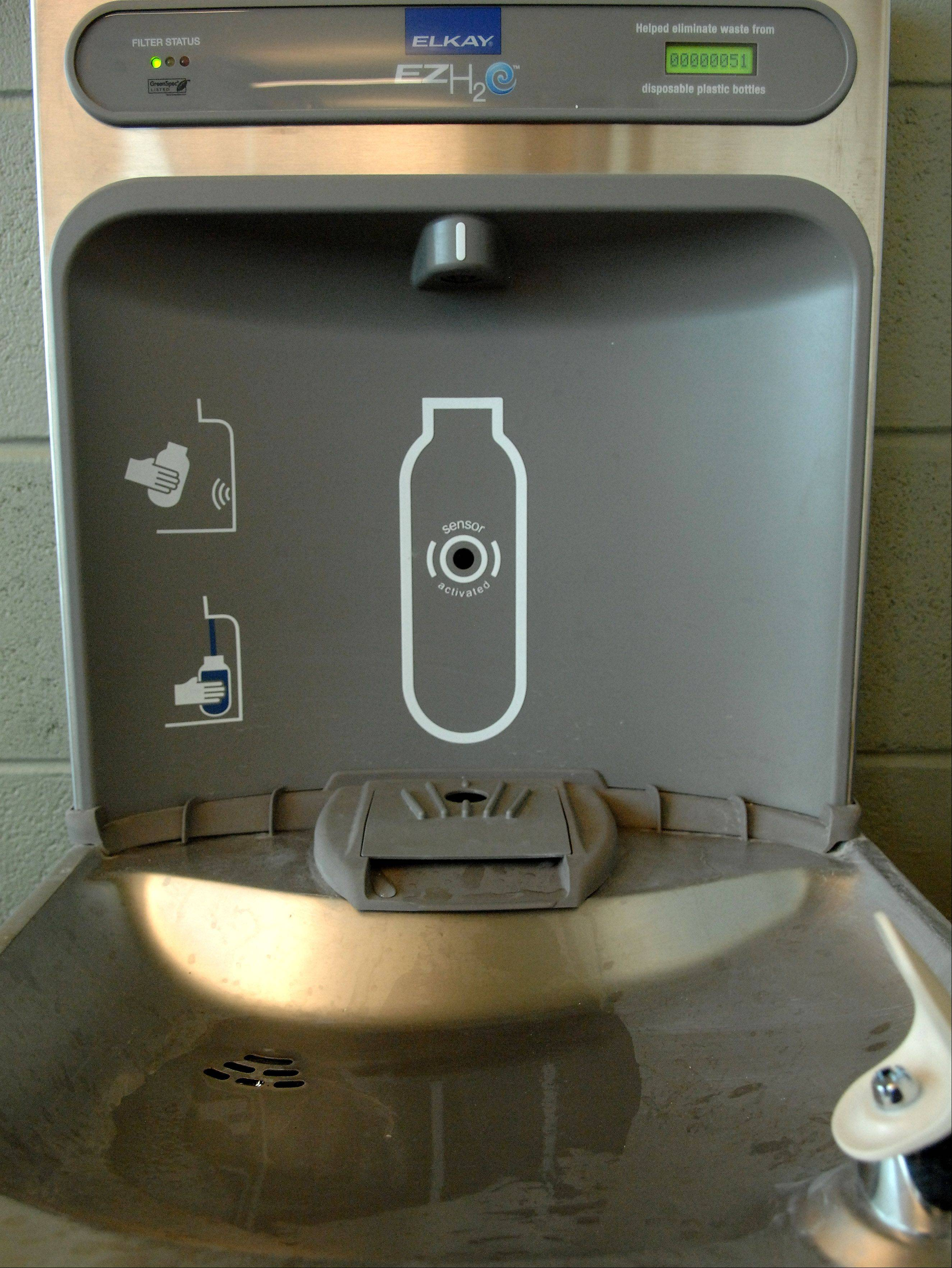 A water fountain doubles as a no-touch water bottle refill station.