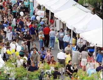 Hundreds of people crowd downtown Arlington Heights at a previous year's Mane Event party.