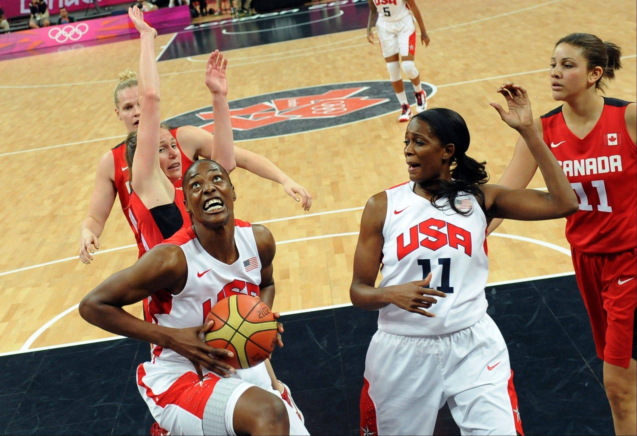 United States' center Sylvia Fowles, left, goes for a basket during a women's quarterfinal basketball match against Canada at the 2012 Summer Olympics on Tuesday, Aug. 7, 2012, in London.
