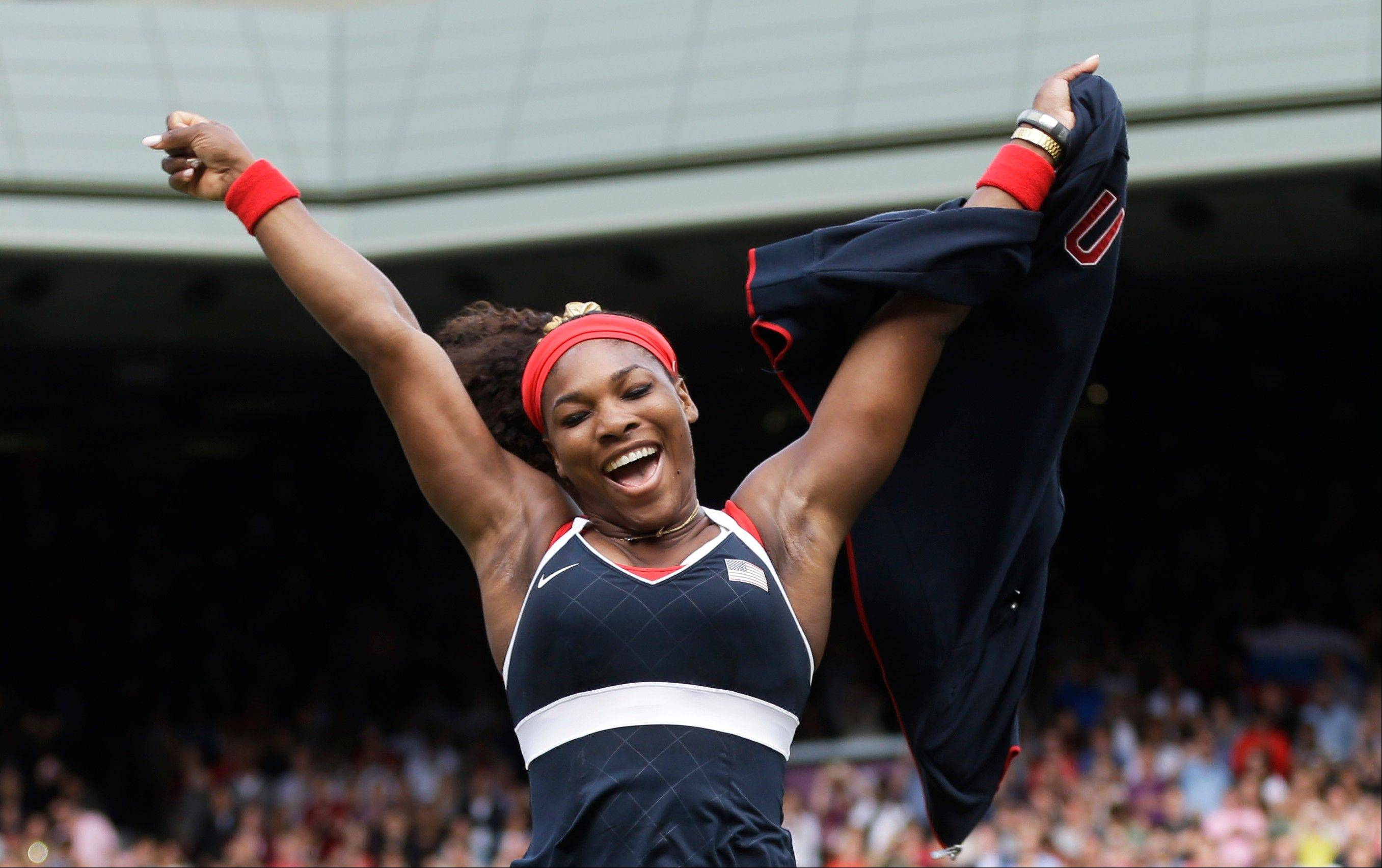 In this Saturday, Aug. 4, 2012 photo, United States' Serena Williams celebrates after defeating Maria Sharapova of Russia to win the women's singles gold medal match at the All England Lawn Tennis Club at Wimbledon, in London, at the 2012 Summer Olympics.