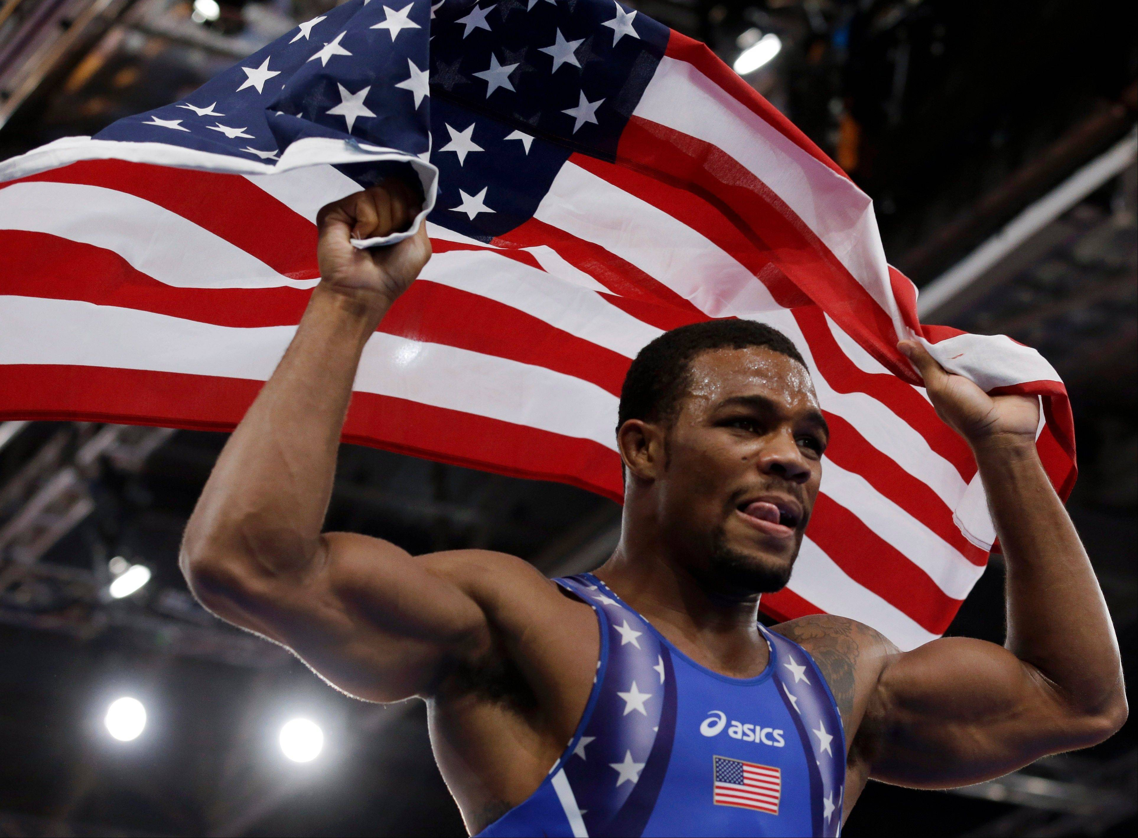 United States wrestler Jordan Burroughs celebrates Friday after beating Iran's Sadegh Saeed Goudarzi in the freestyle gold medal match at 74-kg.