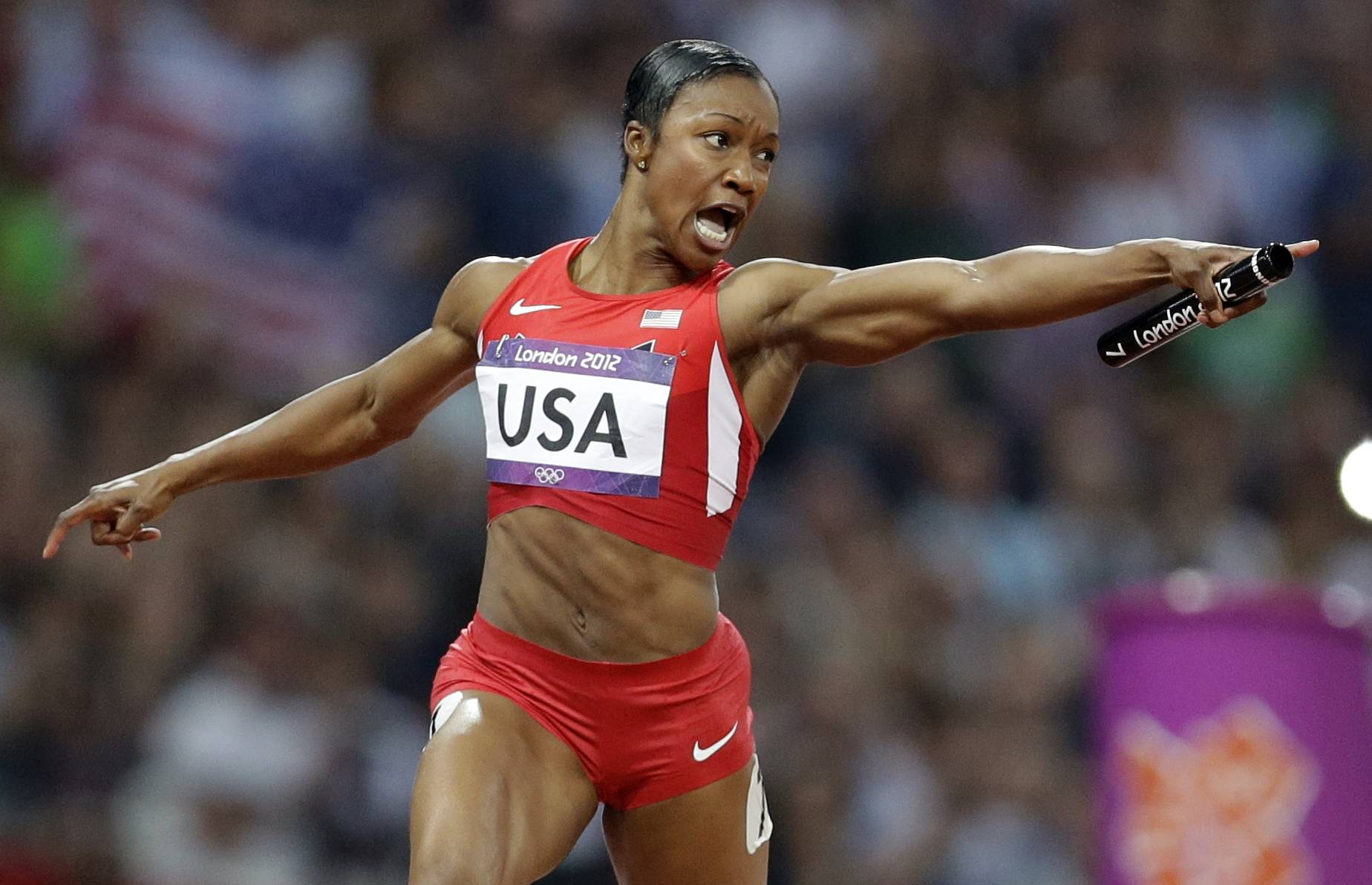 United States sprinter Carmelita Jeter reacts Friday as she crosses the finish line to win the women's 4x 100-meter relay. The United States relay team set a new world record with a time of 40.82 seconds.