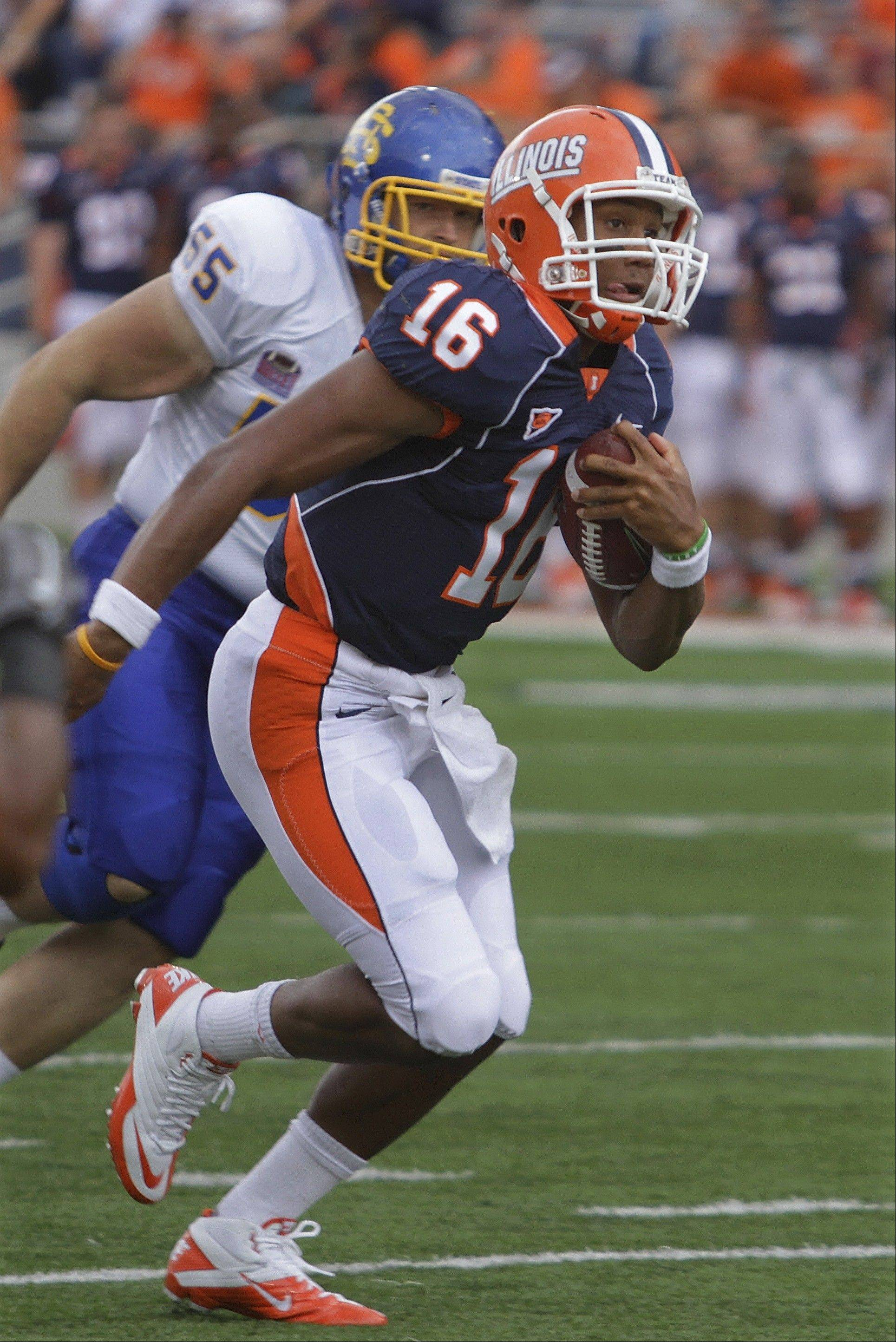 Illinois quarterback Miles Osei (16), a former star at Prospect High School, is in a battle with sophomore quarterback Reilly O'Toole, a former Wheaton Warrenville South star, for the No. 2 QB role at Illinois.