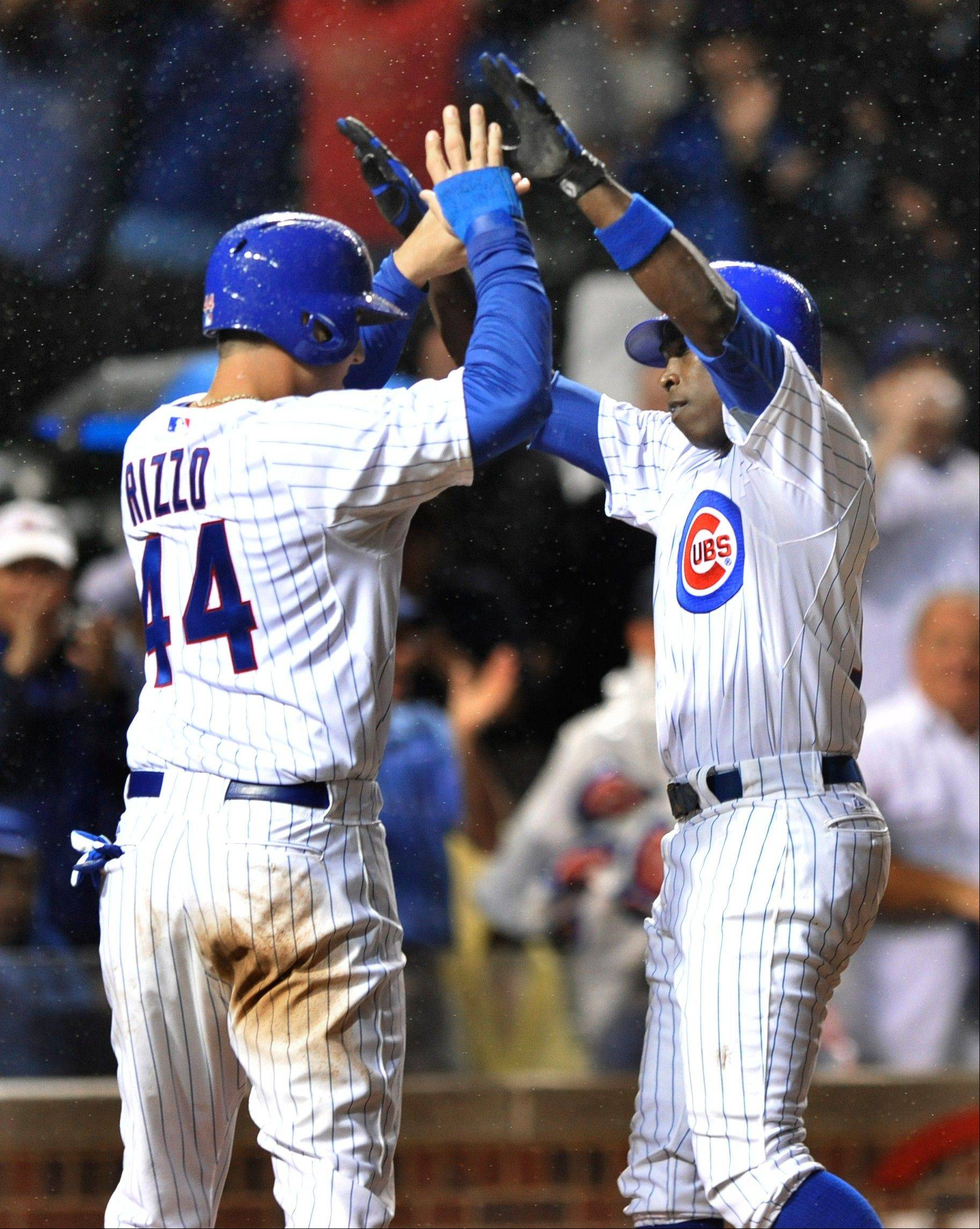 Alfonso Soriano right, celebrates with teammate Anthony Rizzo left, after hitting the game-winning 2-run homer Thursday against the Reds.The home run was Soriano's 20th of the season. It marked the 11th straight year he has hit at least 20. He joined Albert Pujols and David Ortiz as the only sluggers to have 11 consecutive 20-plus-homer seasons, including 2012