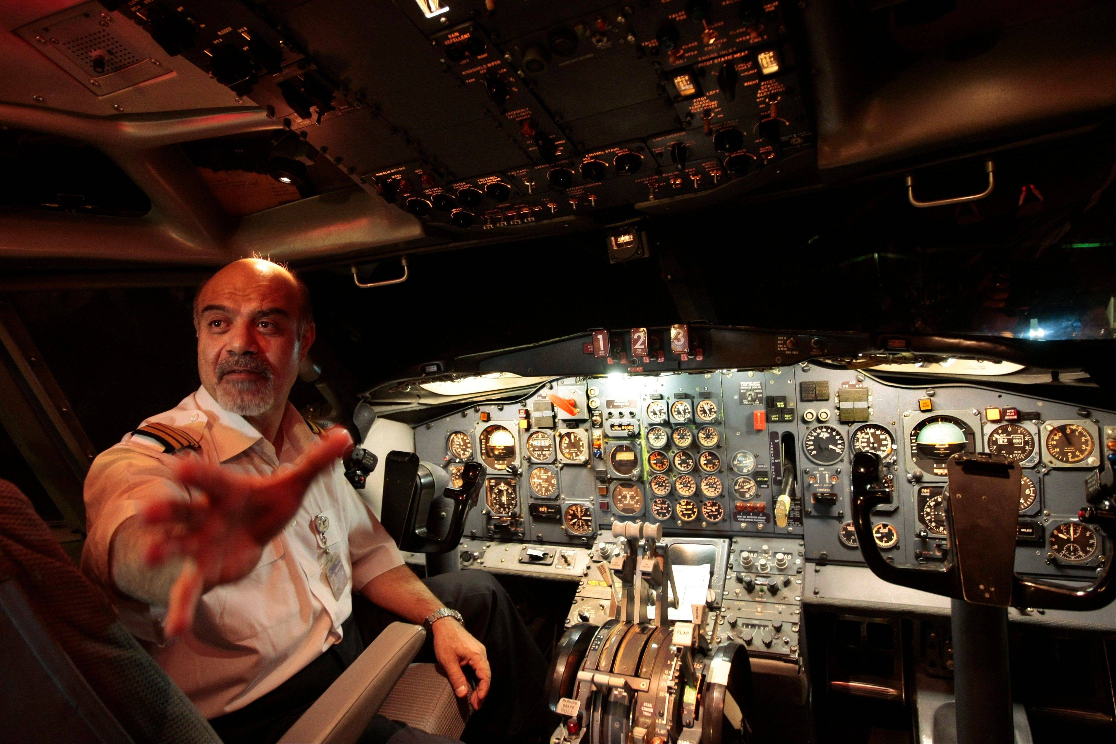 Captain Hooshang Shahbazi in a flight simulator at the Mehrabad airport in Tehran, Iran.