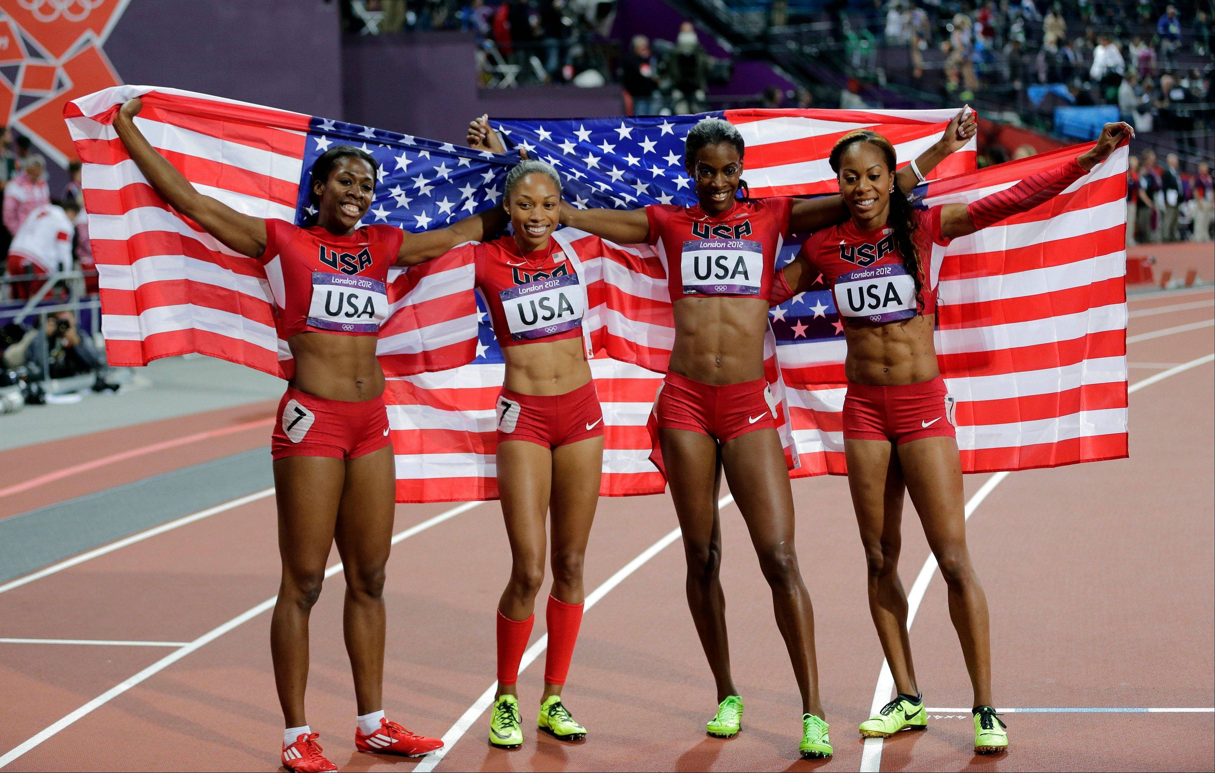From left, United States' Francena McCorory, United States' Allyson Felix, United States' Deedee Trotter and United States' Sanya Richards-Ross celebrate winning gold in the women's 4x400-meter relay final during the athletics in the Olympic Stadium at the 2012 Summer Olympics, London, Saturday, Aug. 11, 2012.