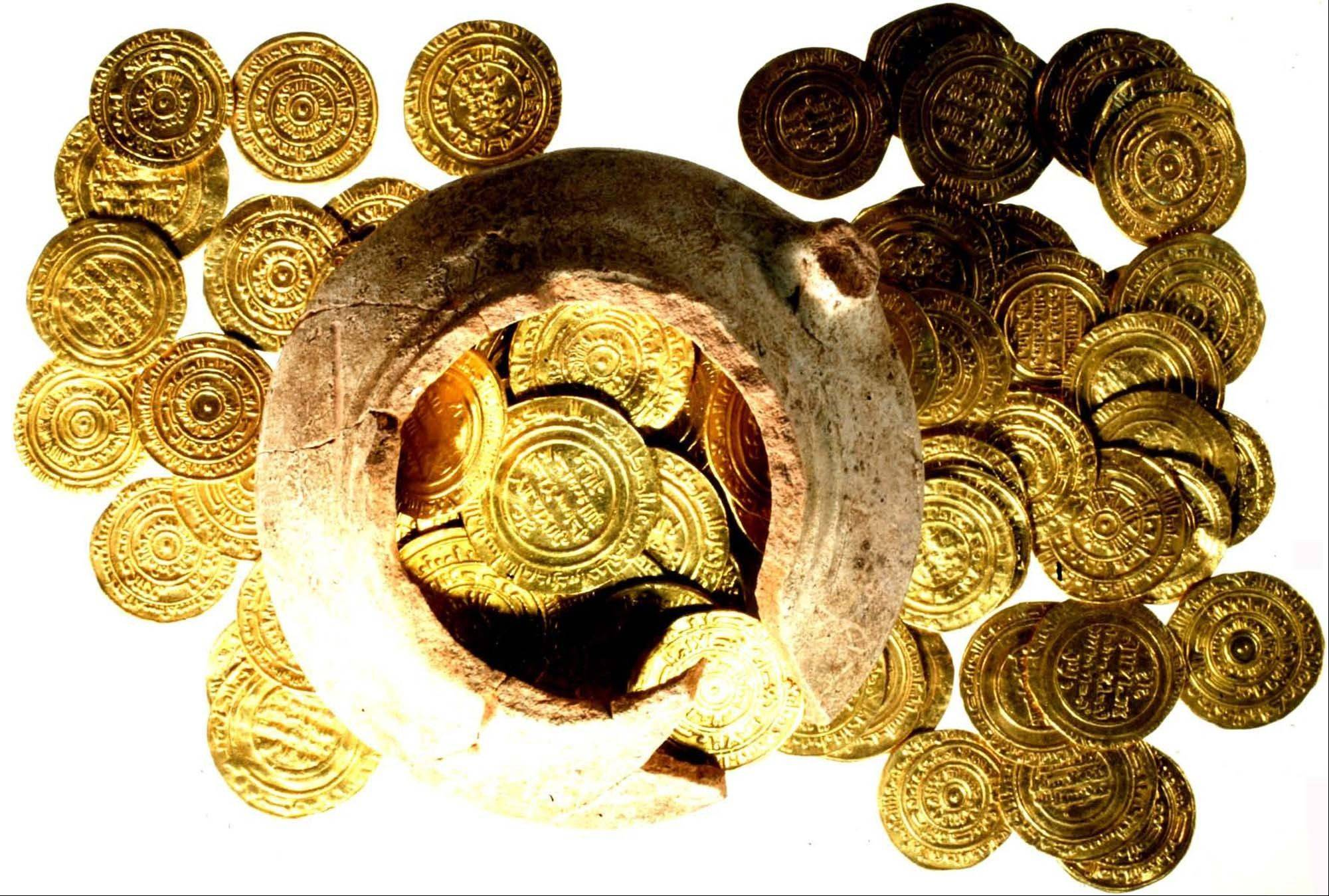 A hoard of gold coins is shown in this undated handout photo. Two gold dinars, the type of gold currency found, would have provided sufficiently for an extended family for one month.