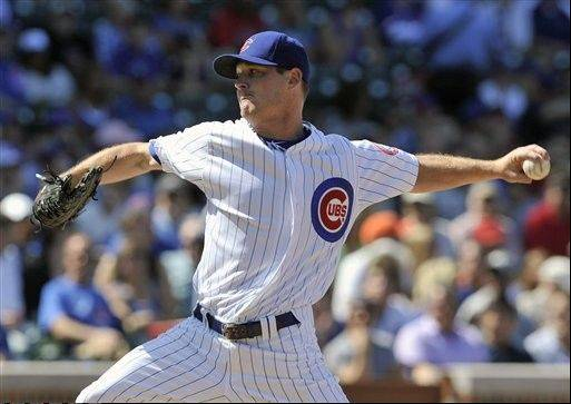 Chicago Cubs' Travis Wood pitches against the Cincinnati Reds during the first inning of a baseball game Saturday, Aug. 11, 2012, in Chicago. (AP Photo/Jim Prisching)